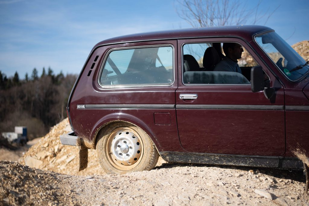 lada niva 4x4 quarry off road rear half tire dirty