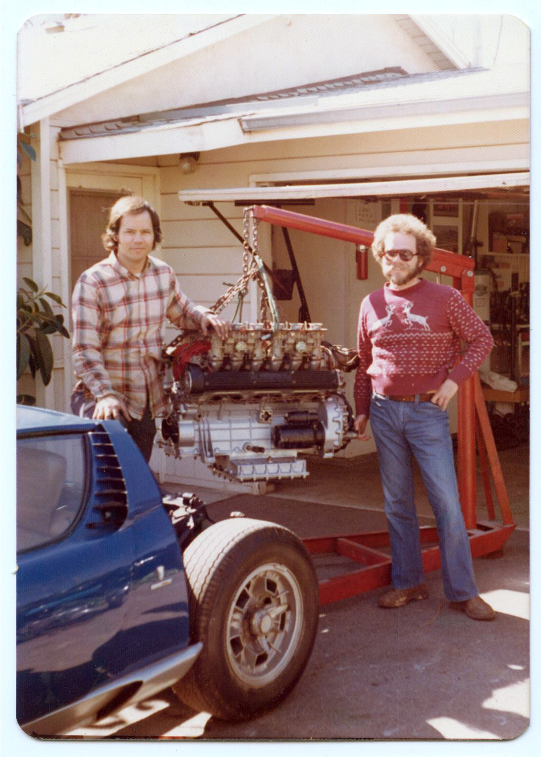 Eric Seltzer and a friend pull the engine from his 1968 Miura