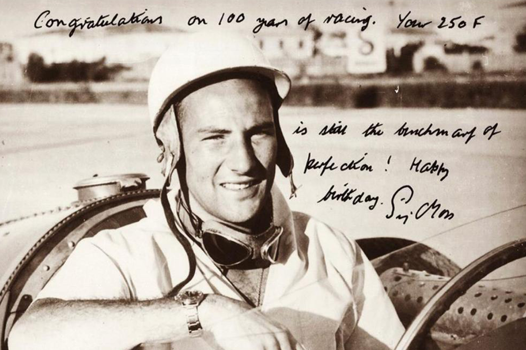 Young Sir Stirling Moss in Cockpit