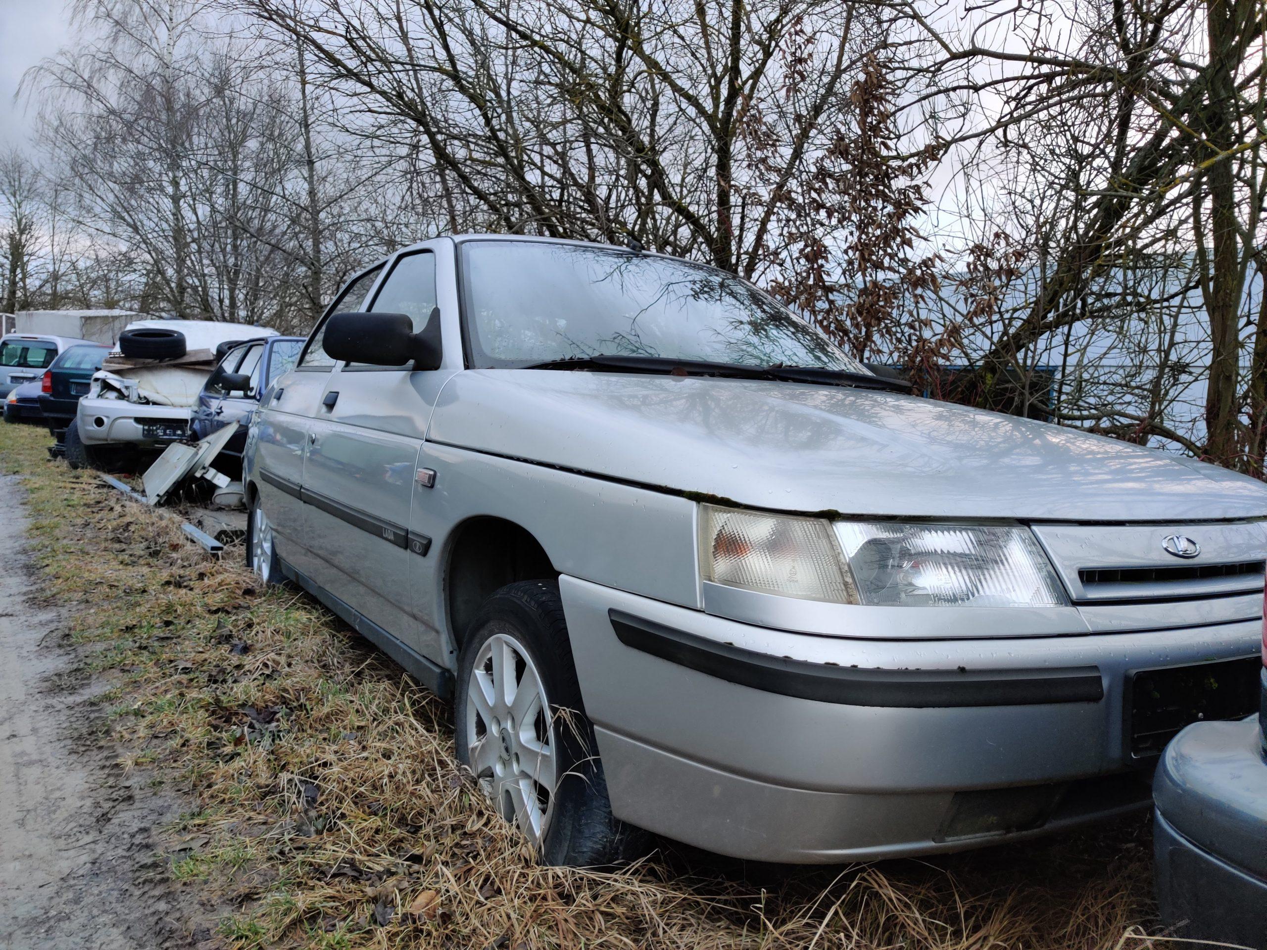 lada 110 sedan silver front left three quarter