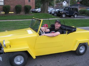 yellow king midget owner and son on a drive