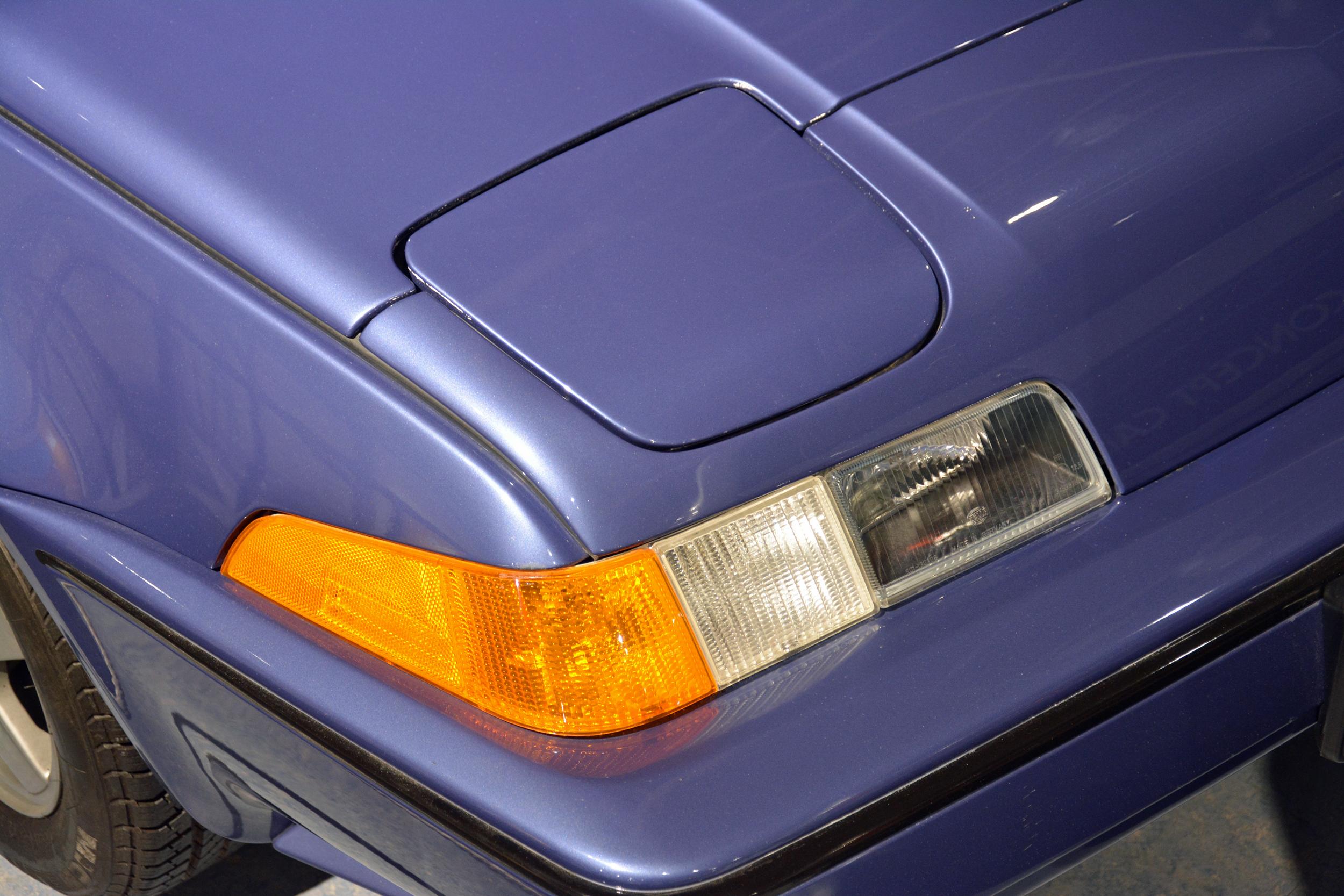 saab museum volvo 480 convertible turbo headlight detail