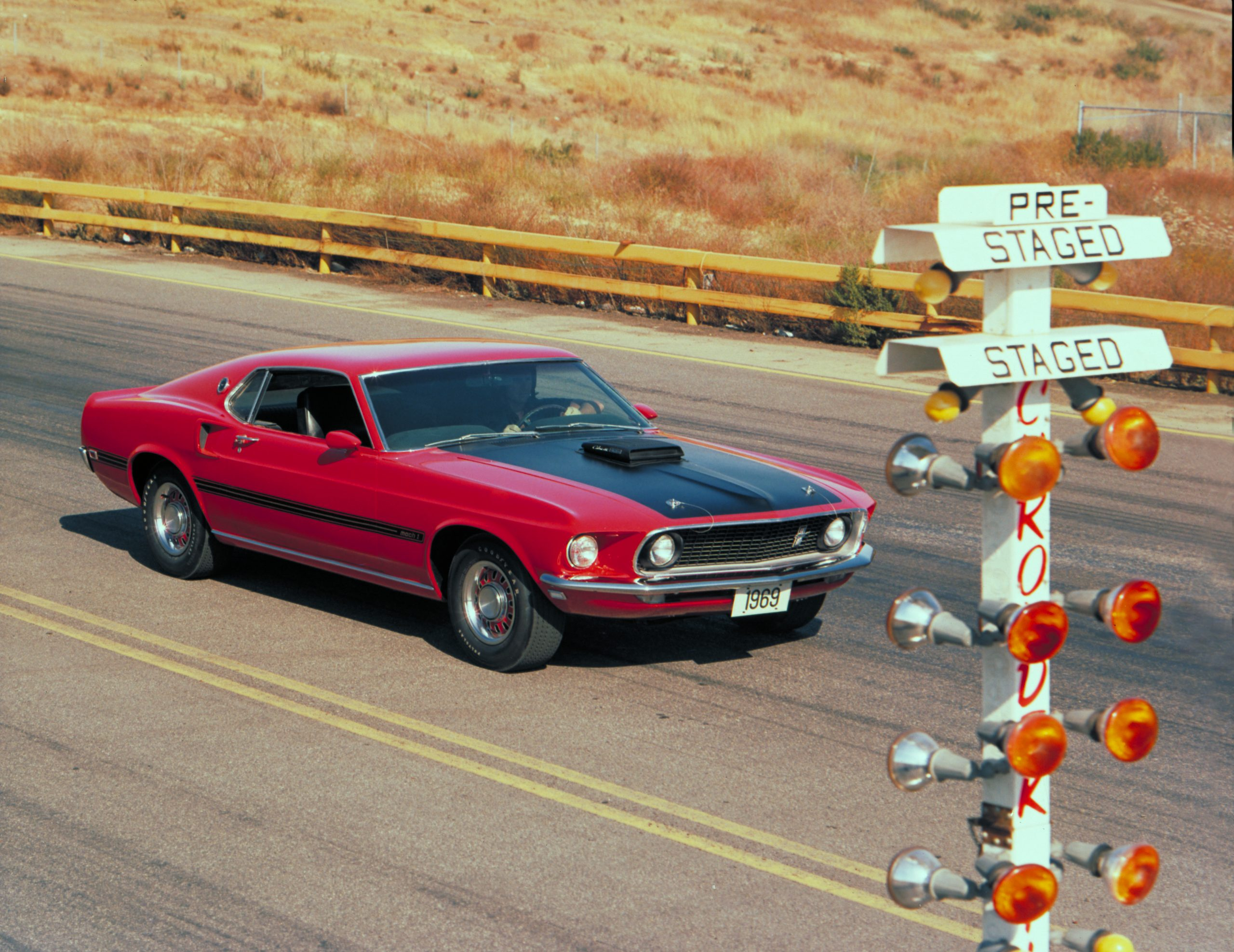 1969 Red Ford Mustang Mach 1 Fastback Front Three-Quarter At Track