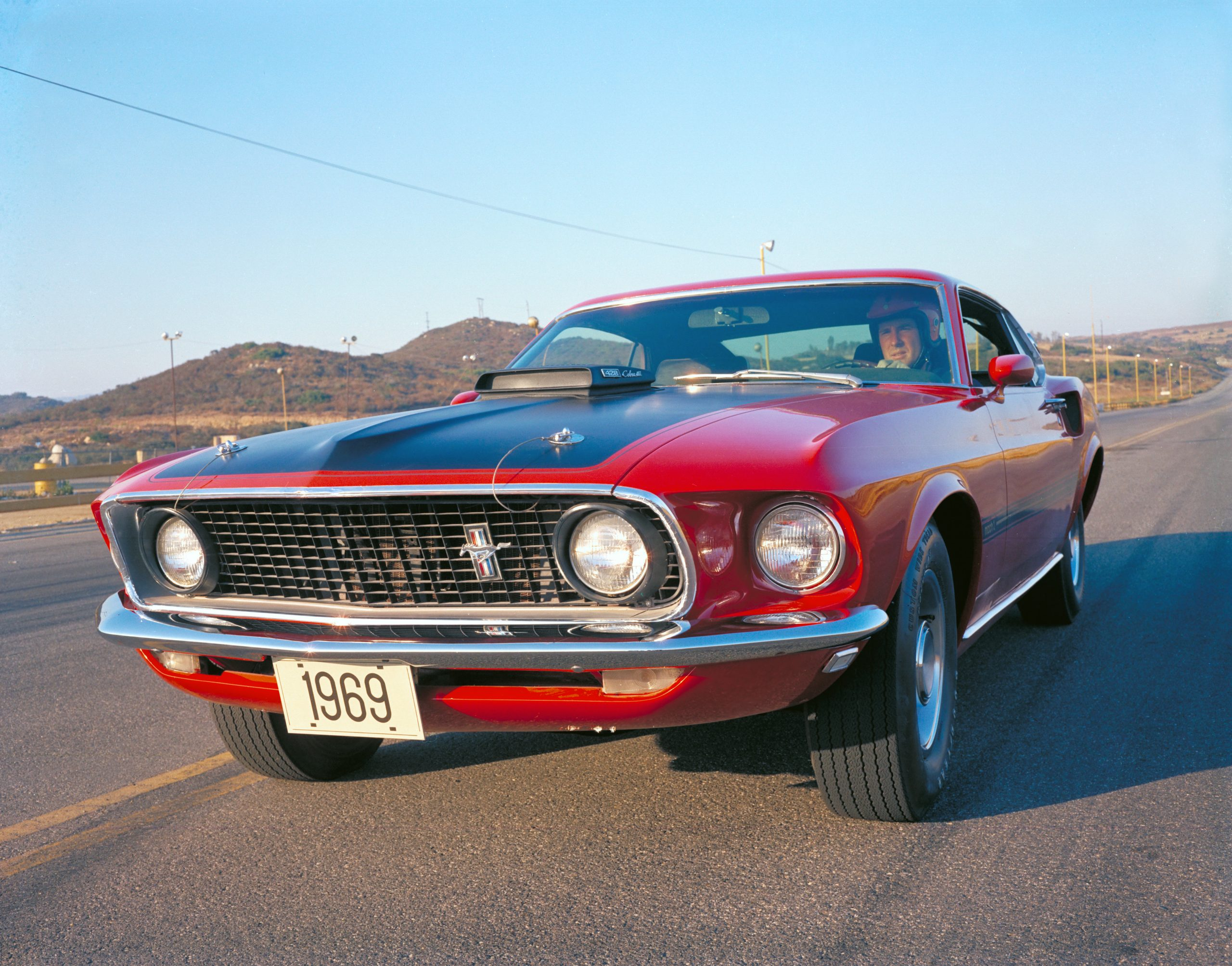 1969 Red Ford Mustang Mach 1 Fastback Front Three-Quarter On Track Action