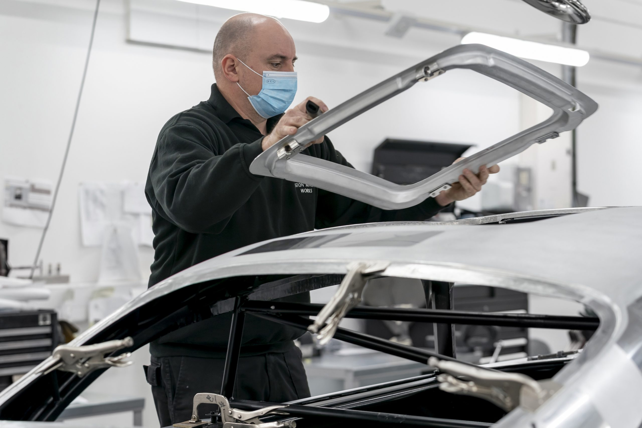 James Bond DB5 Goldfinger Worker Installs Window Panel