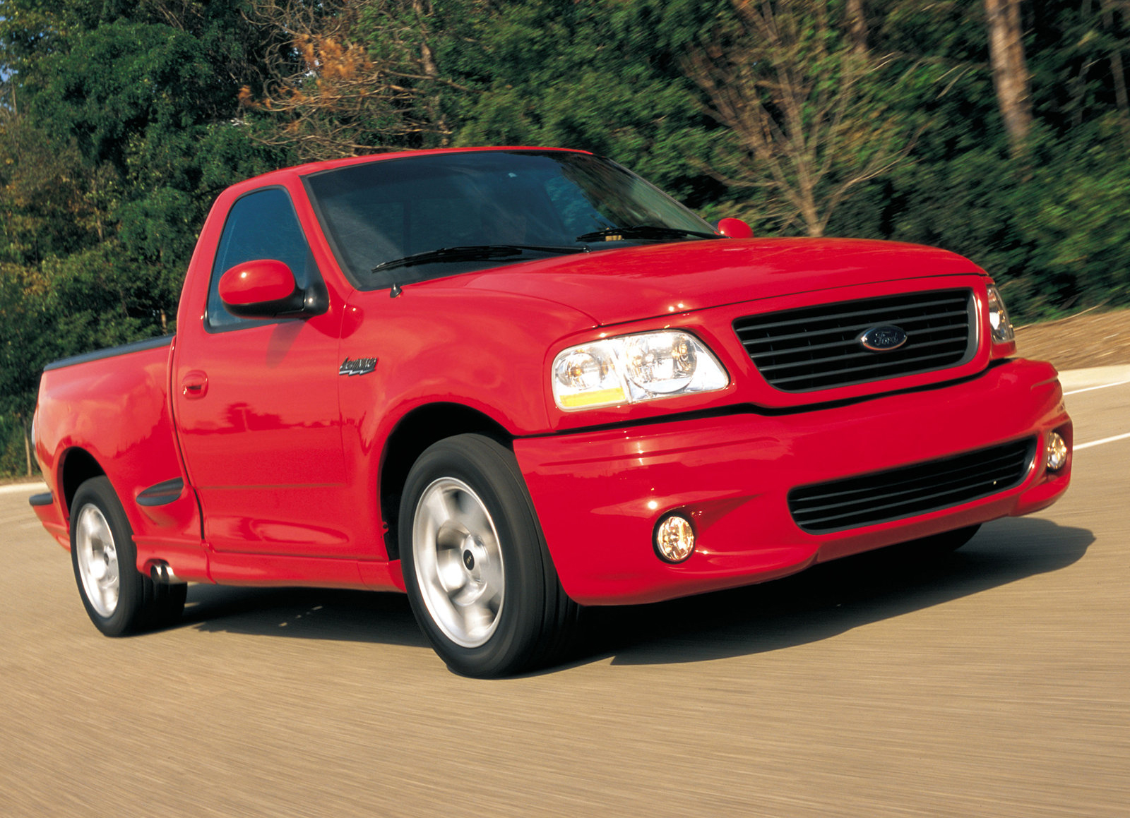 2001 Red Ford SVT Lightning Front Three-Quarter On Road Action