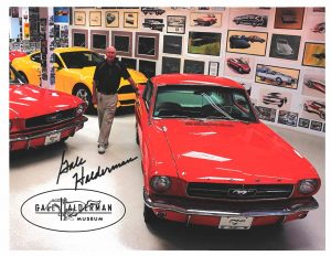 Gale Halderman Stands Beside Mustang In Museum