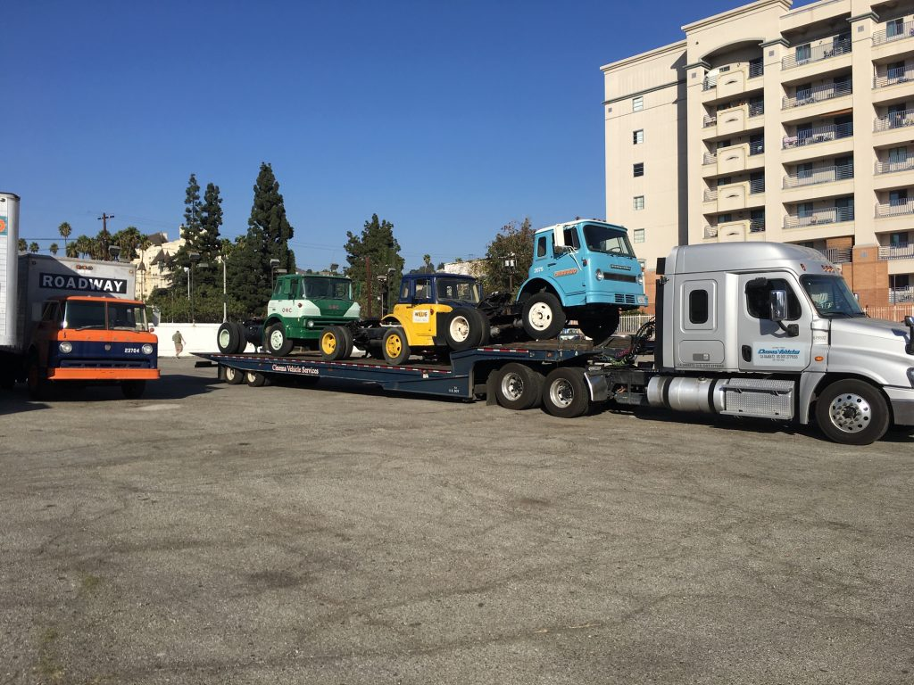 Movie Prop Trucks Loaded on Semi Flatbed