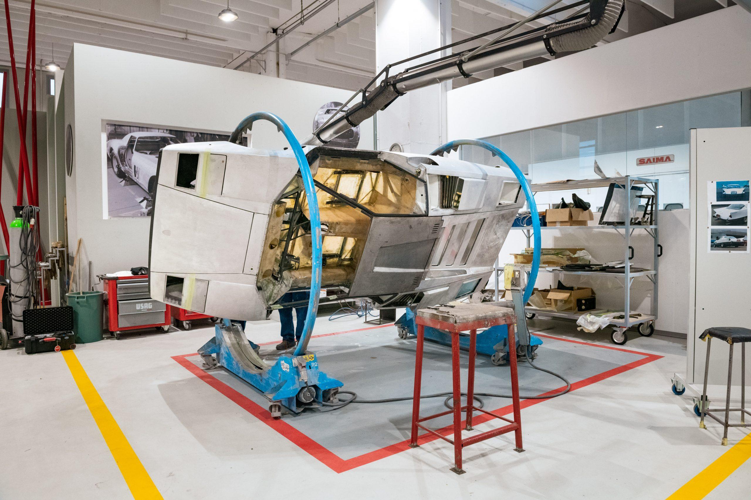 lamborghini countach restoration body sideways in rotisserie machine