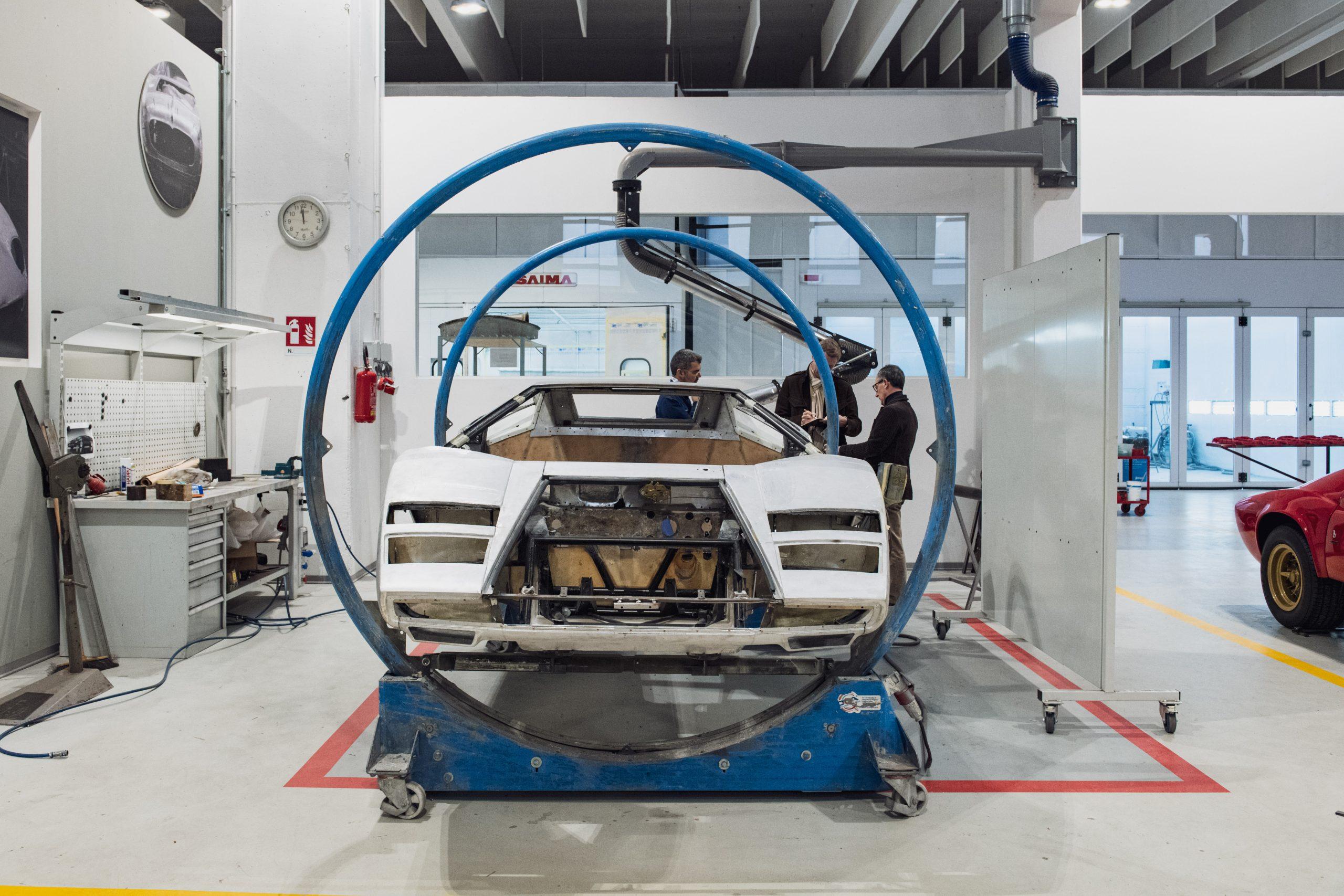 lamborghini countach restoration body in rotisserie machine
