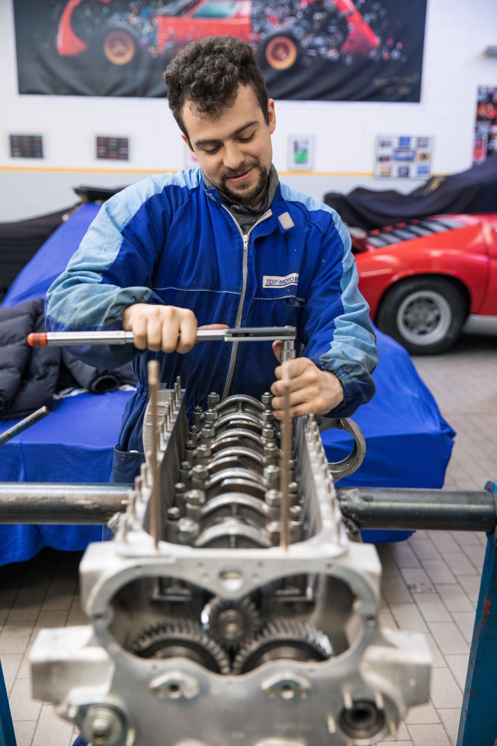 man torques engine nut