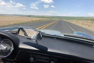 vintage maserati vignale spyder blue skies on open road