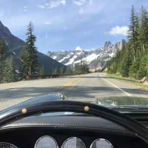 vintage maserati vignale spyder open road and snow capped mountain view