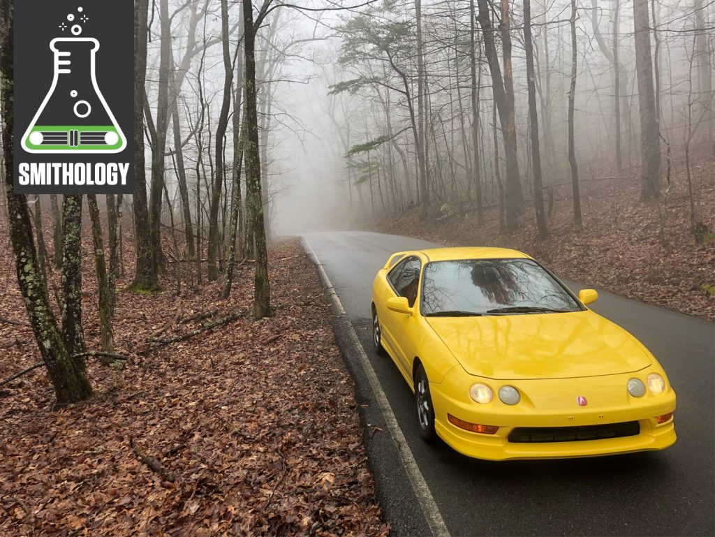 Yellow Acura Front Three-Quarter On Road In Foggy Hills