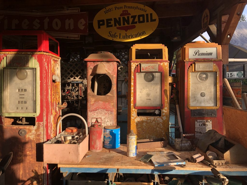 vintage pennzoil pumps and signs