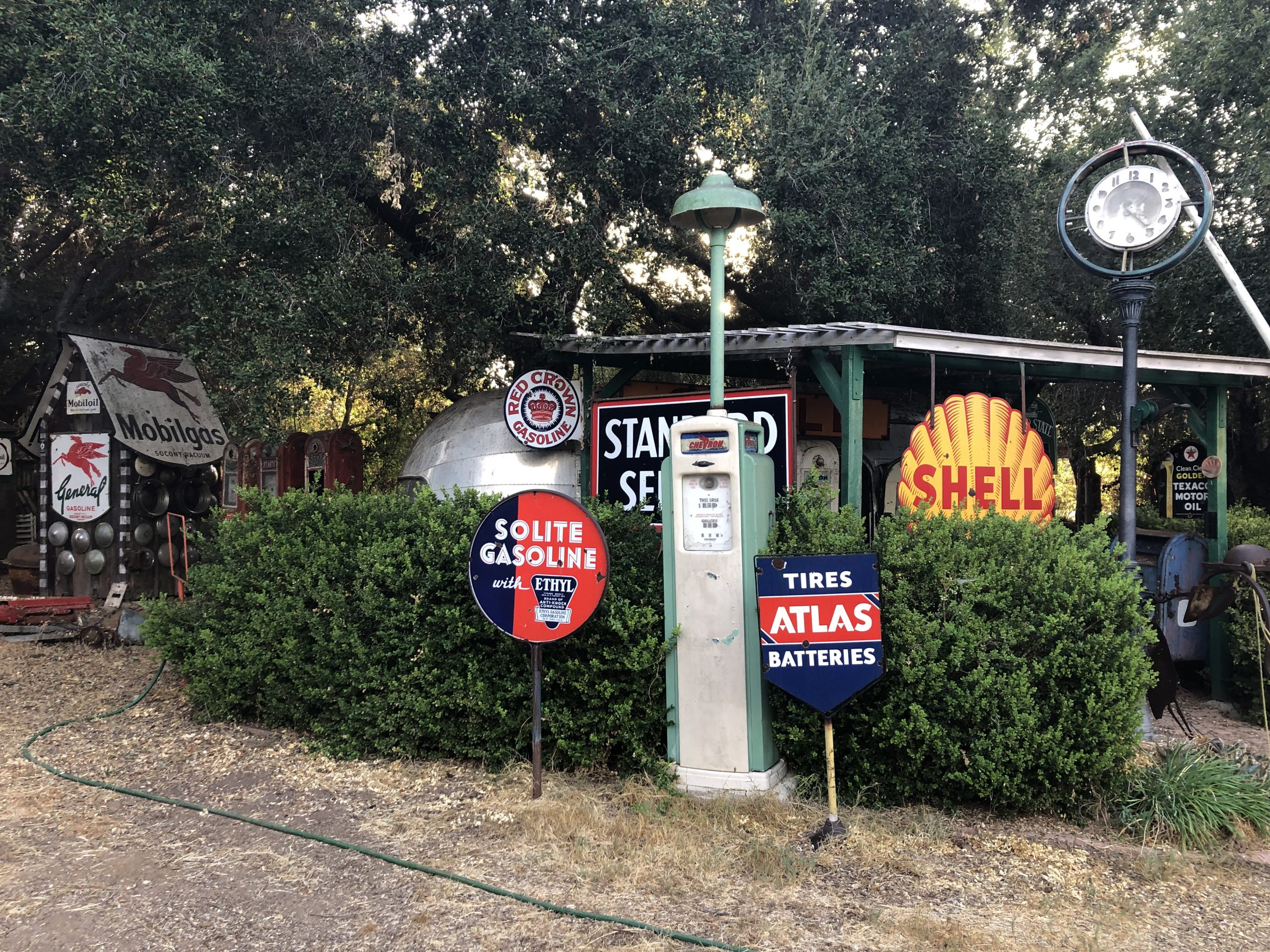 vintage gas station signs and pumps