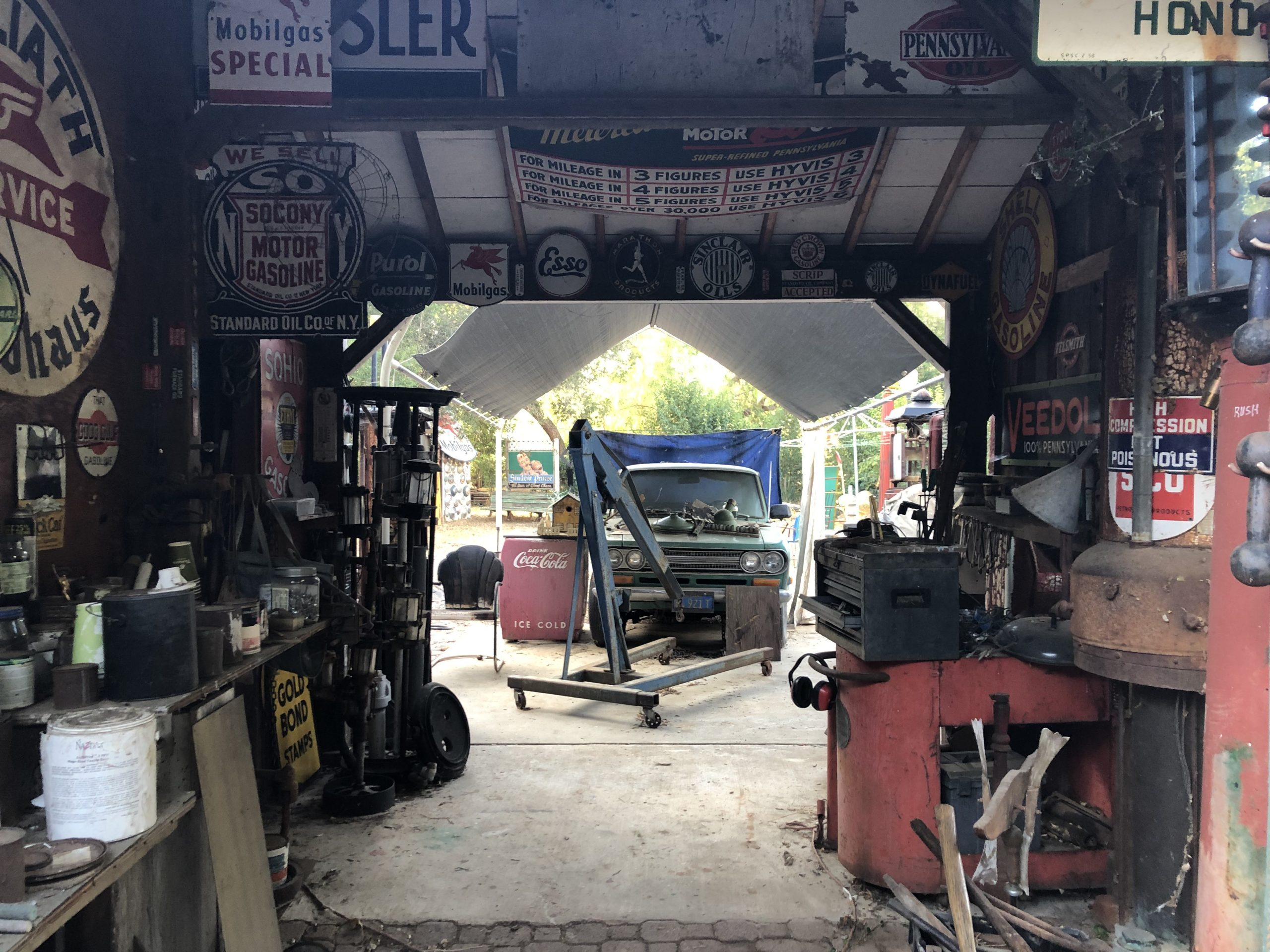 garage filled with vintage gas station sign automobilia