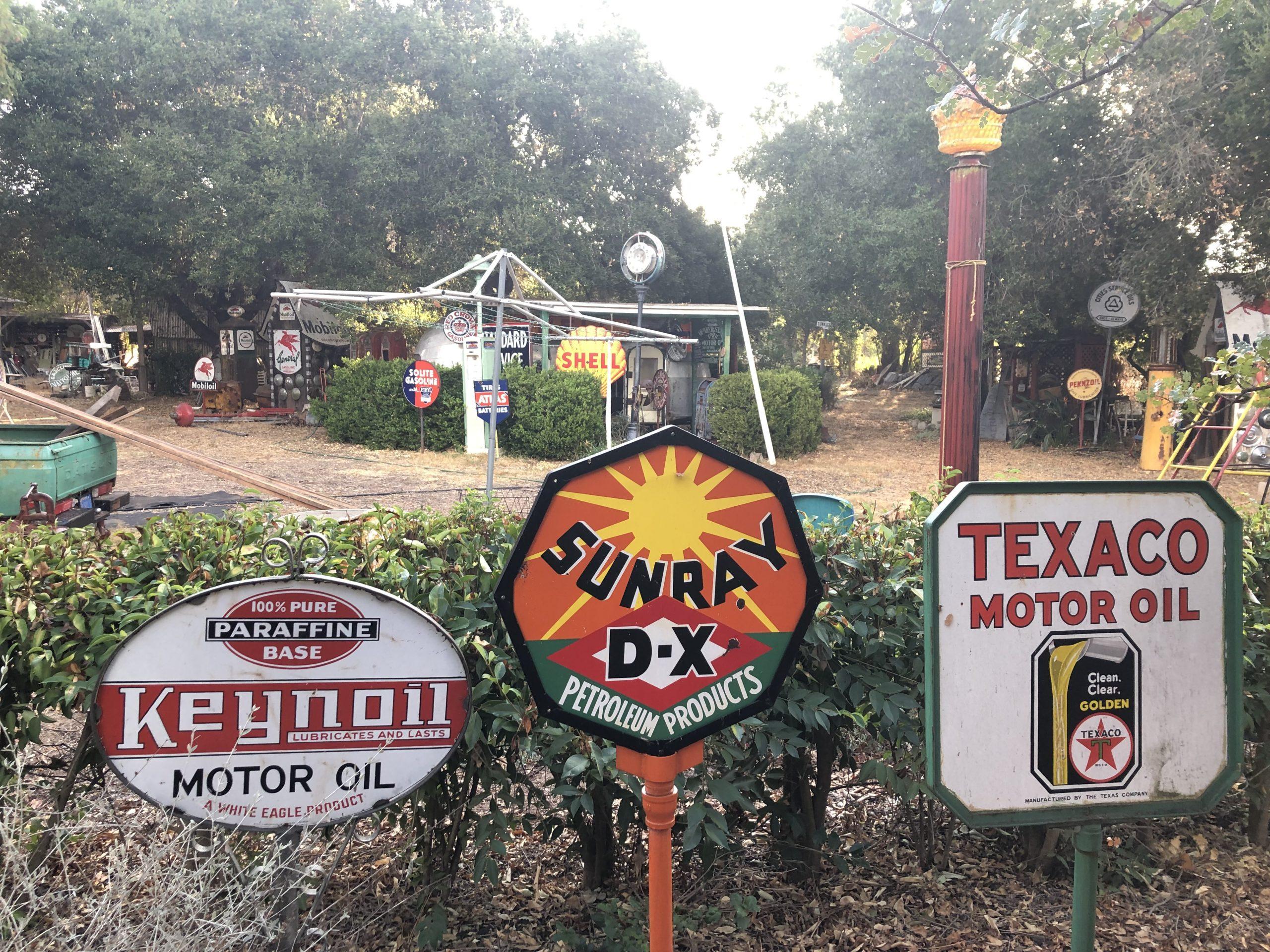 keynoil sunray texaco vintage oil signs in yard