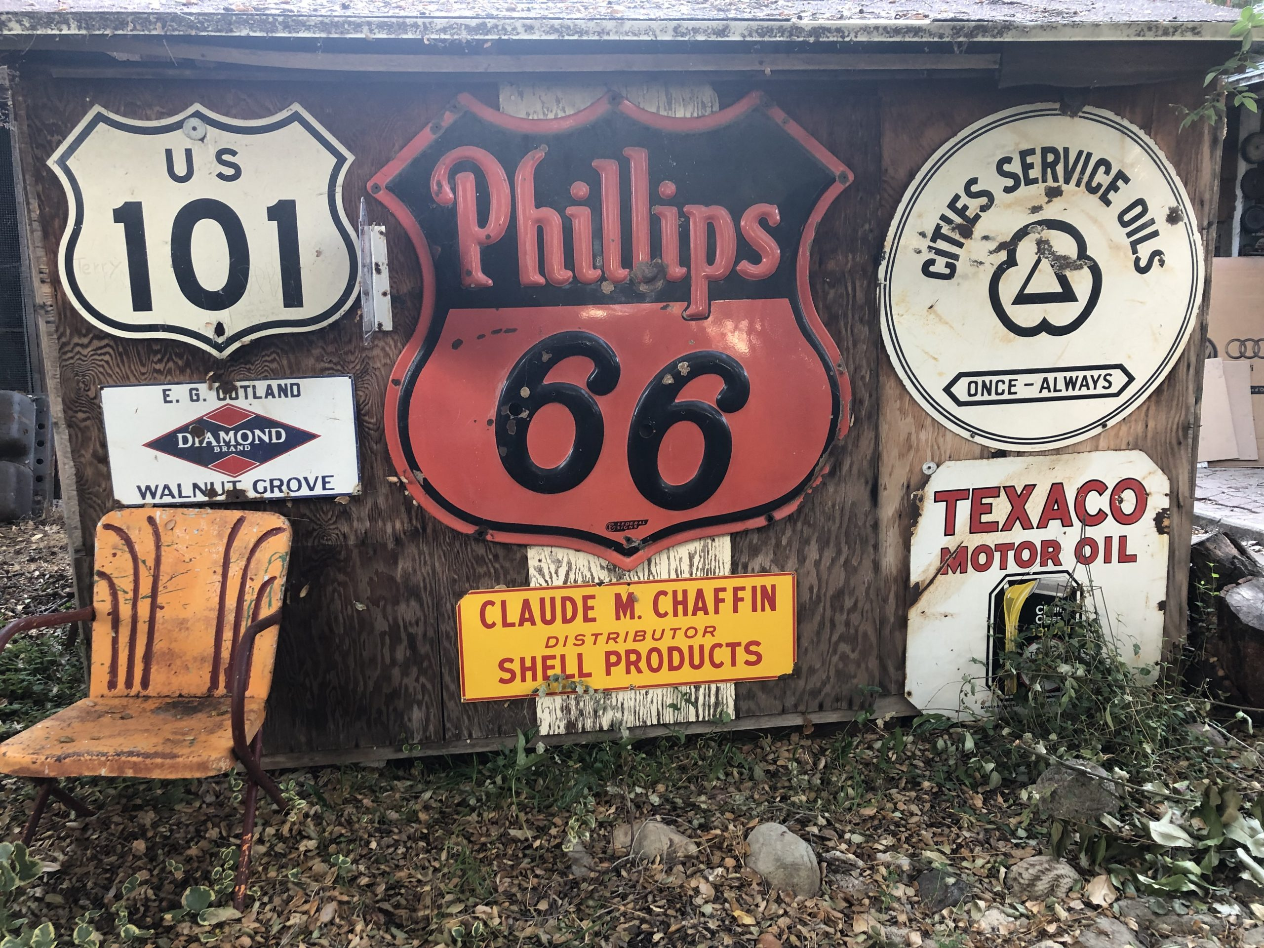 phillips 66 texaco diamond US 101 vintage signs on shed wall