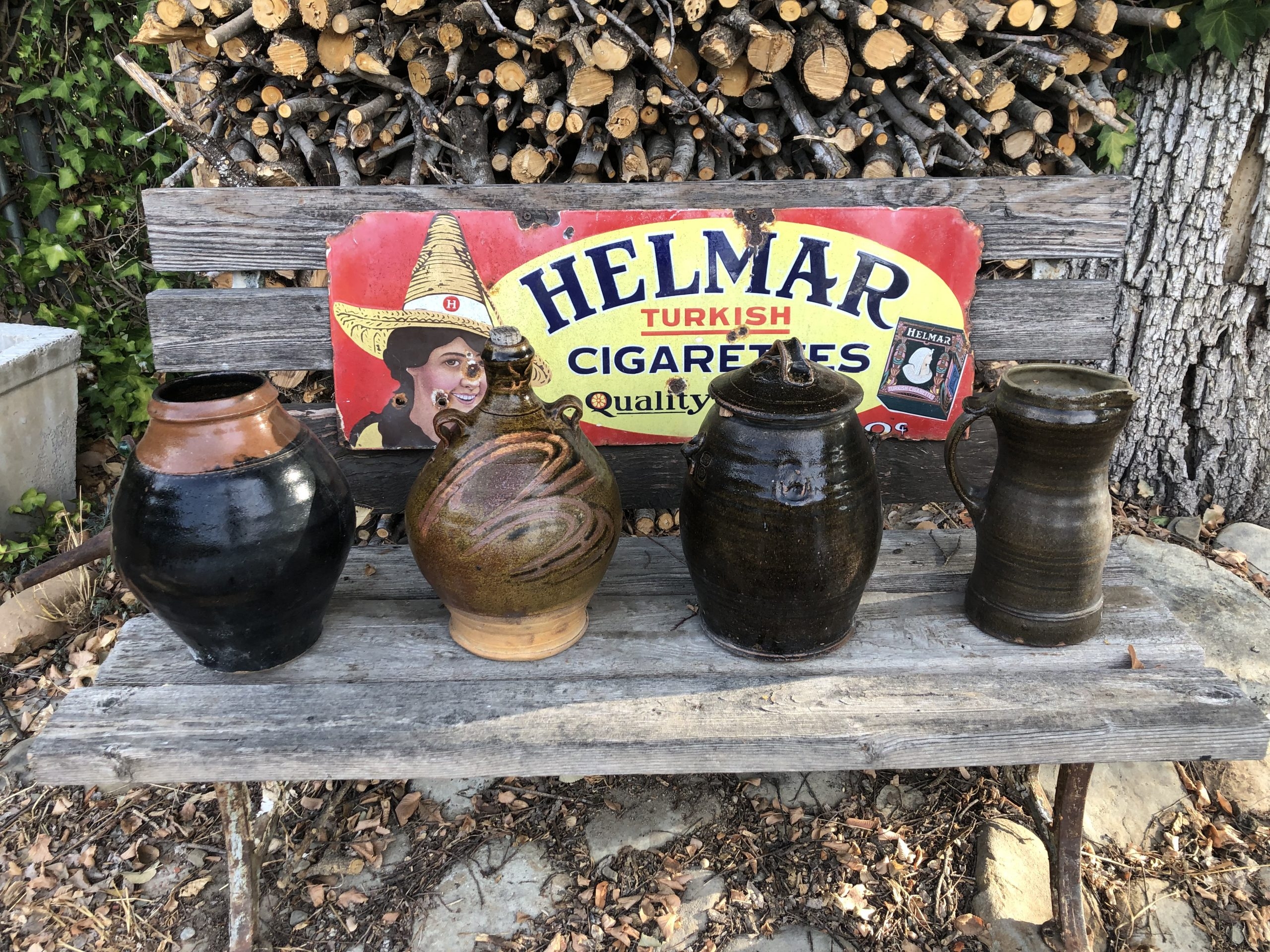 helmar turkish cigarettes sign on bench with antique pots