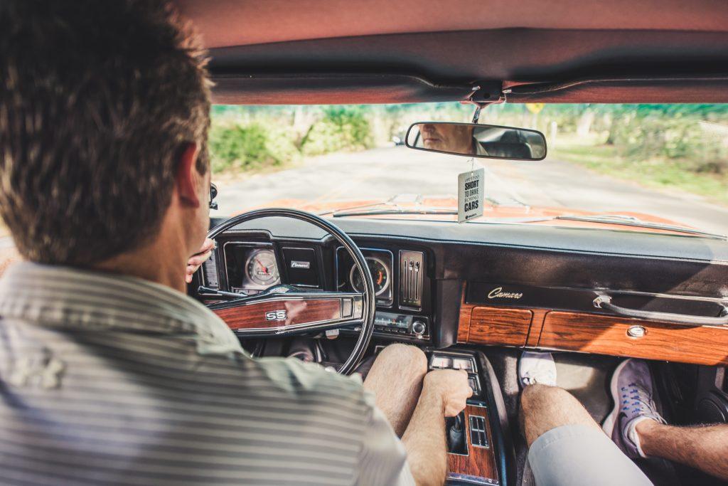Father and Son Driving Camaro Interior