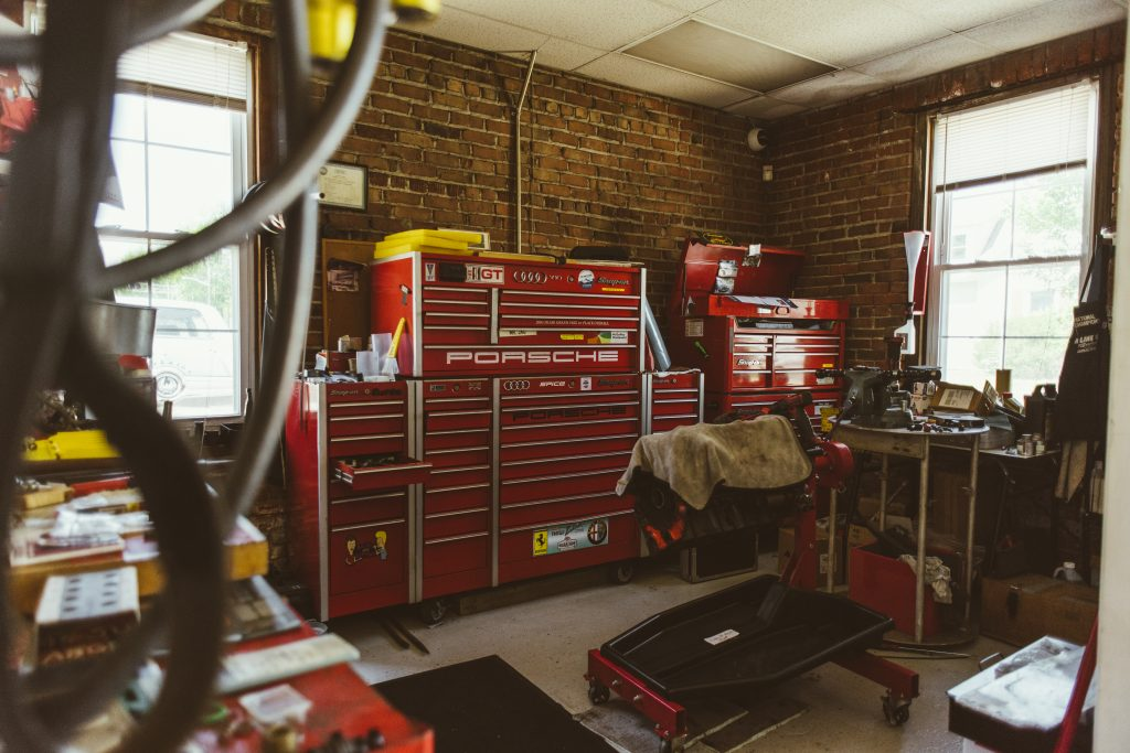 Red Tool Cabinets and Machines in Brick Garage