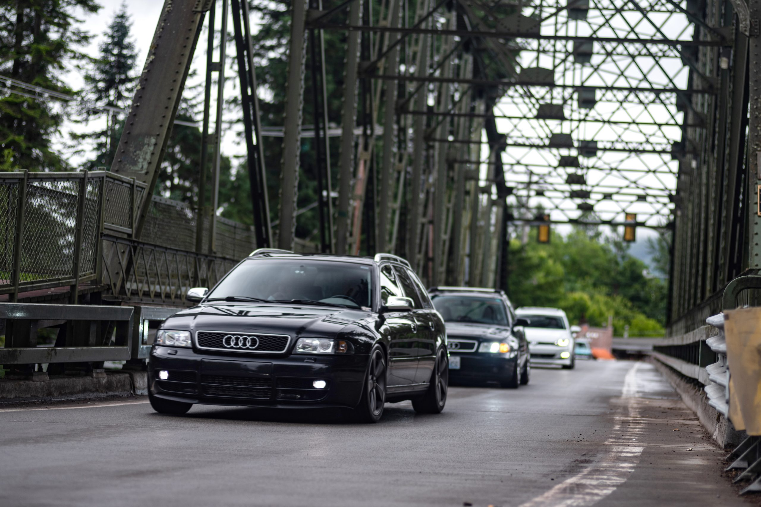 Audi Wagons Bridge Crossing Action Front Three-Quarter