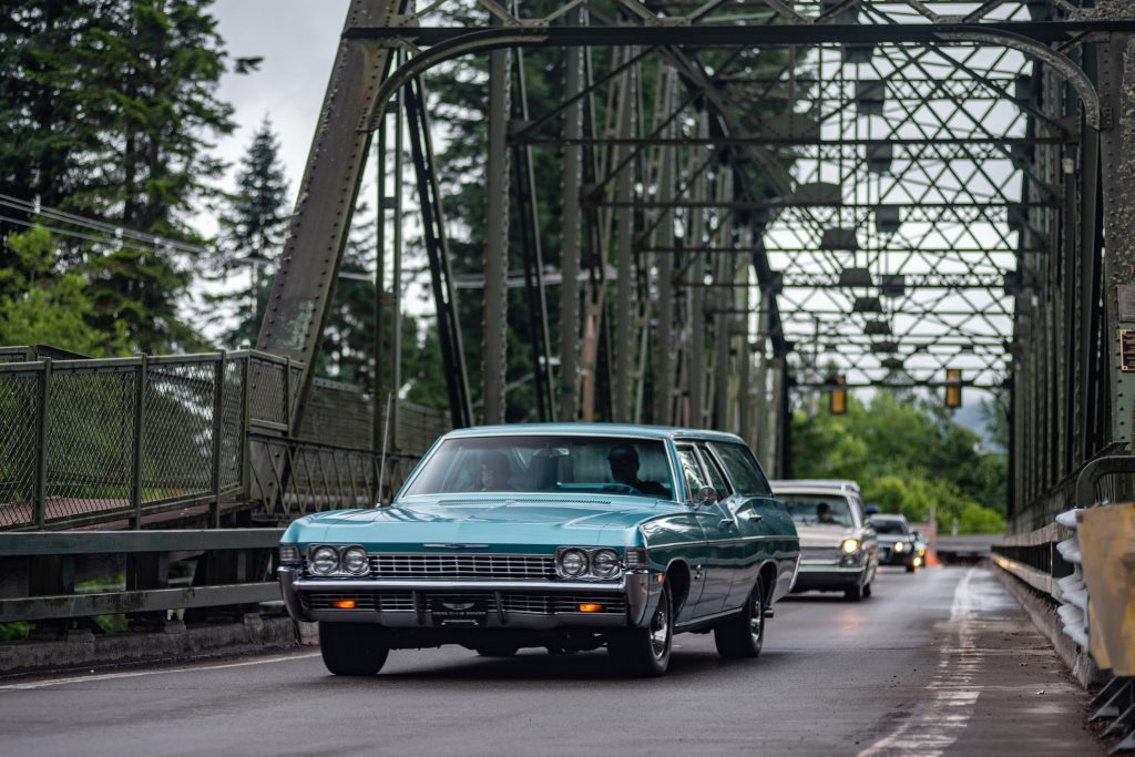 Classic Chevrolet Wagon On Road Action Front Three-Quarter