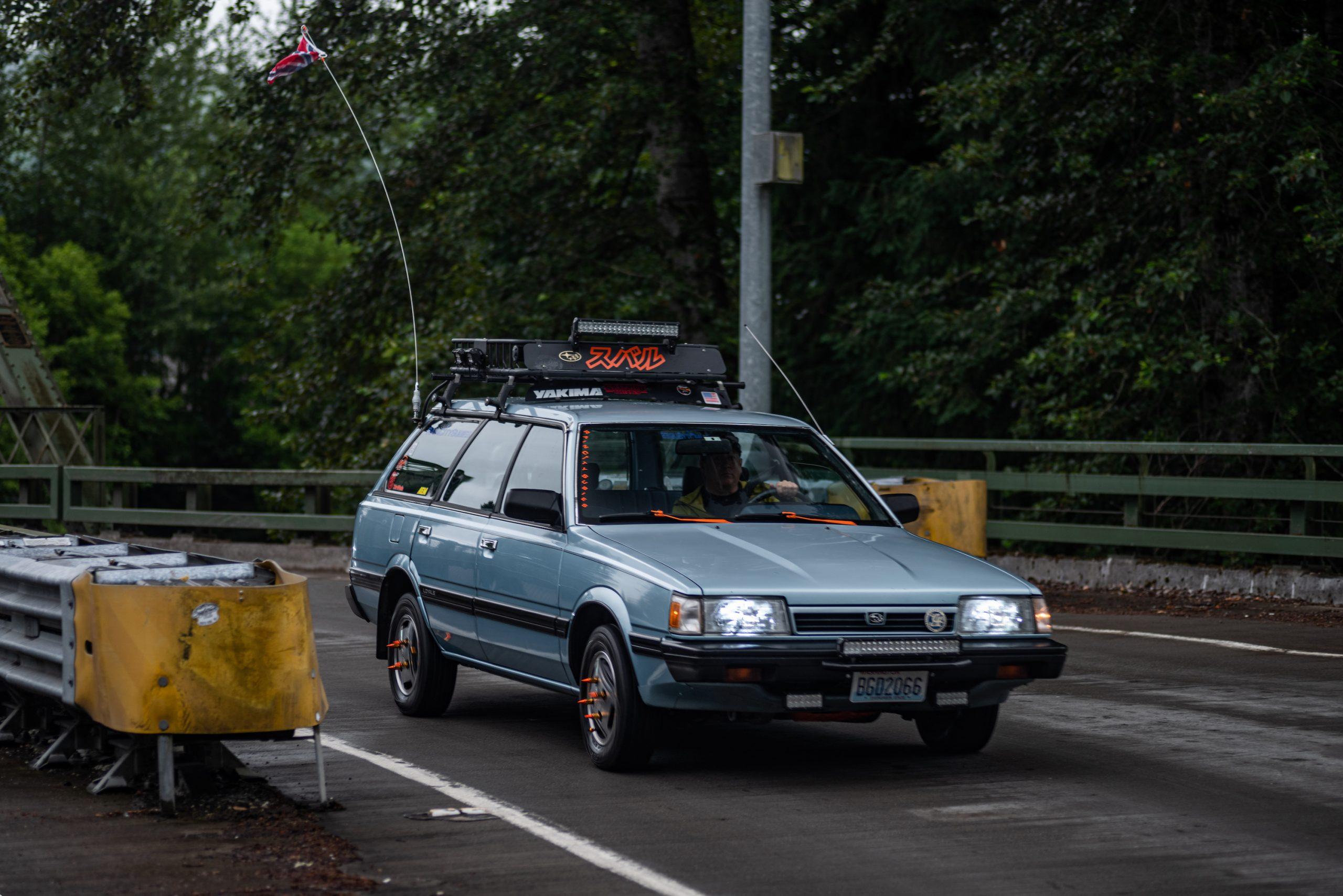 Custom Vintage Subaru Wagon On Road Action Front Three-Quarter