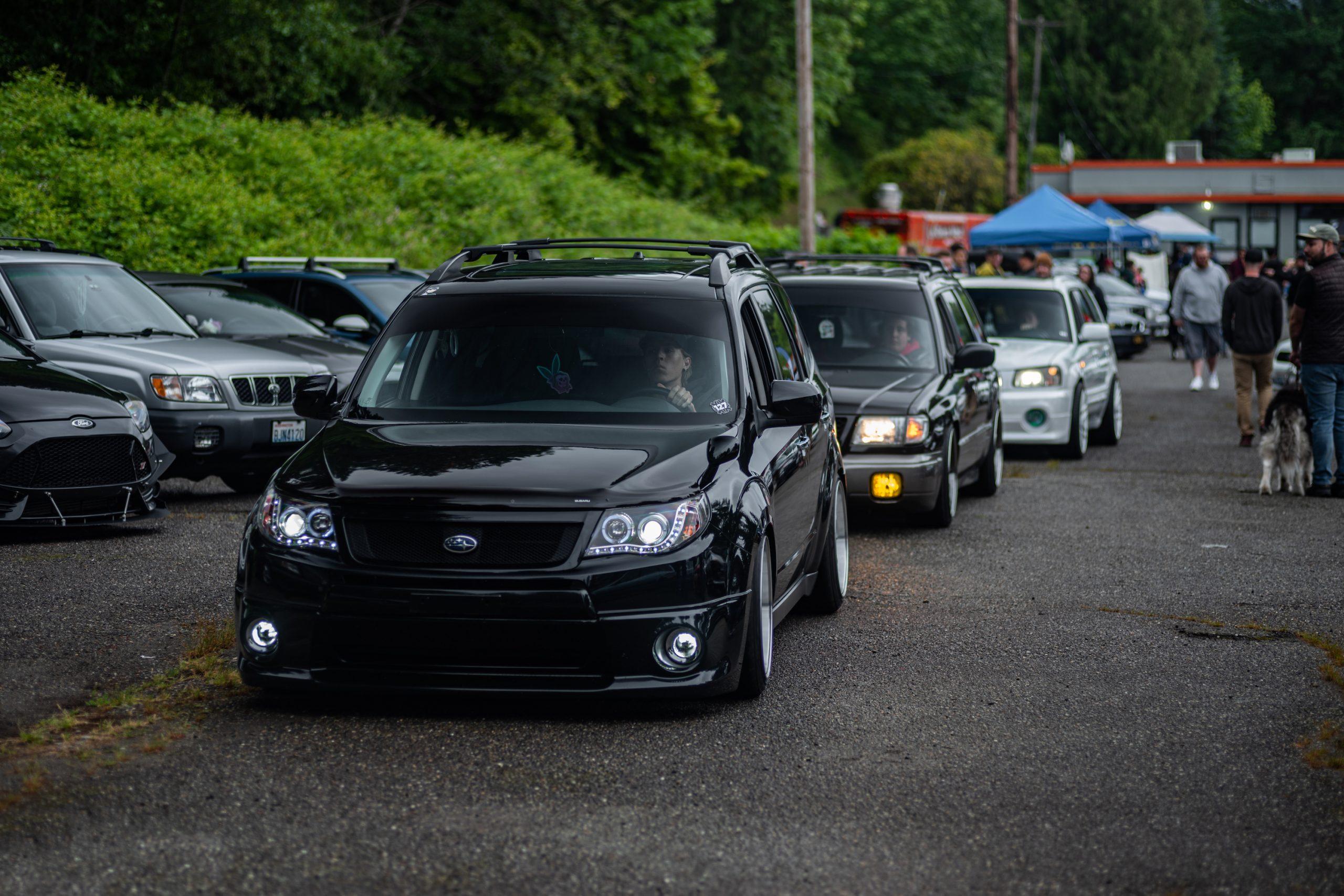 Subaru Wagons Rolling Through Festival