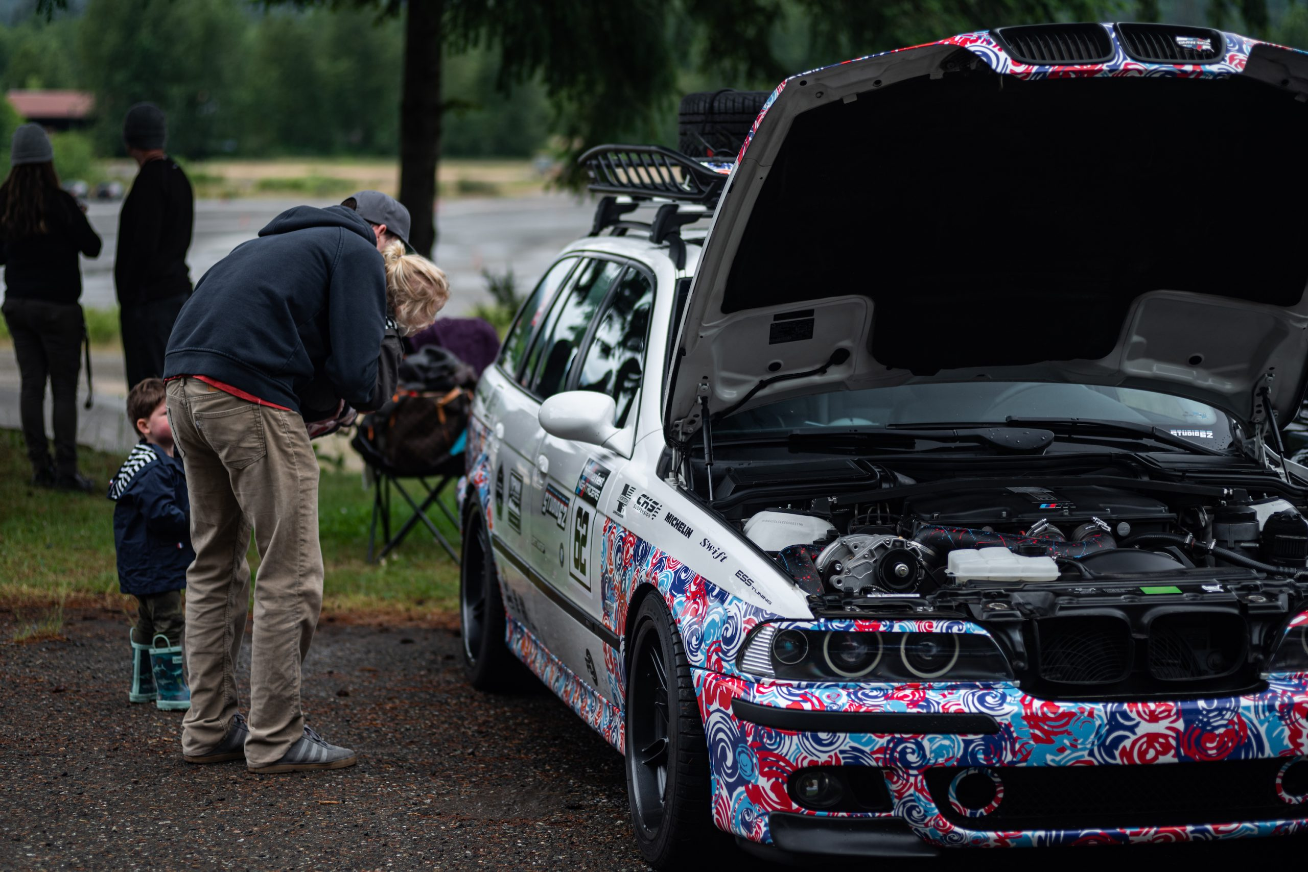 Man and Kids Checking Out Tuner BMW Wagon