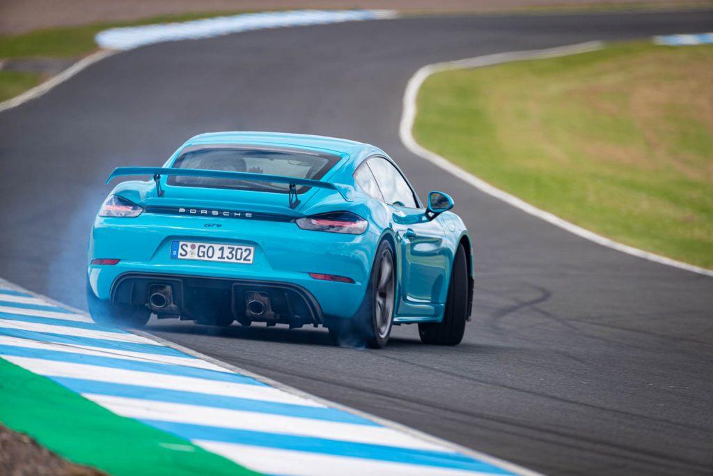 Porsche 78 Cayman GT4 Blue track slide
