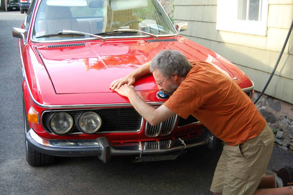 Rob Siegel - Sorting out a car - Rob kissing a BMW