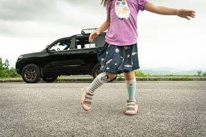 Girl Dances Before Toyota Land Cruiser