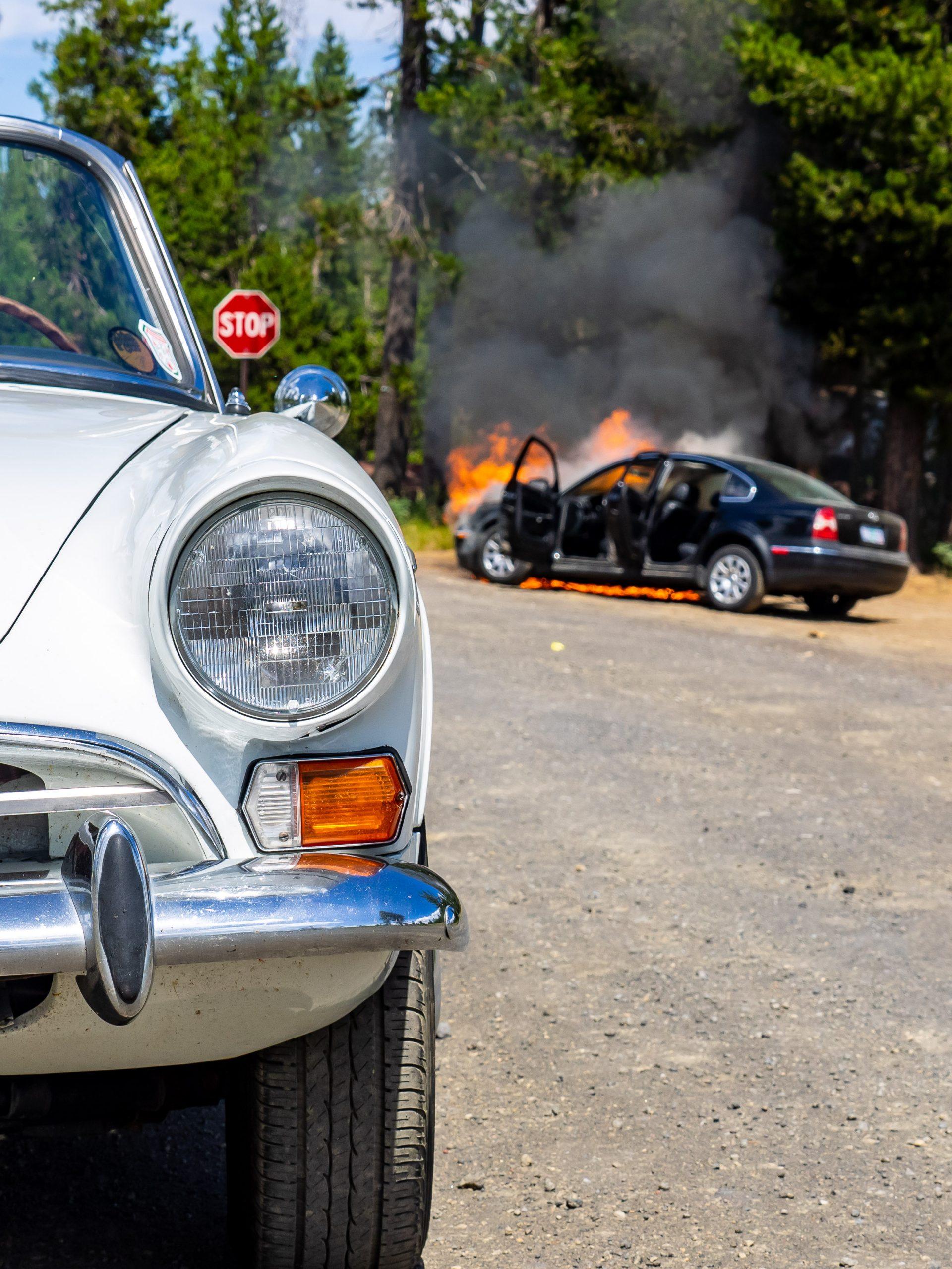 Sunbeam Tiger and Burning VW Passat