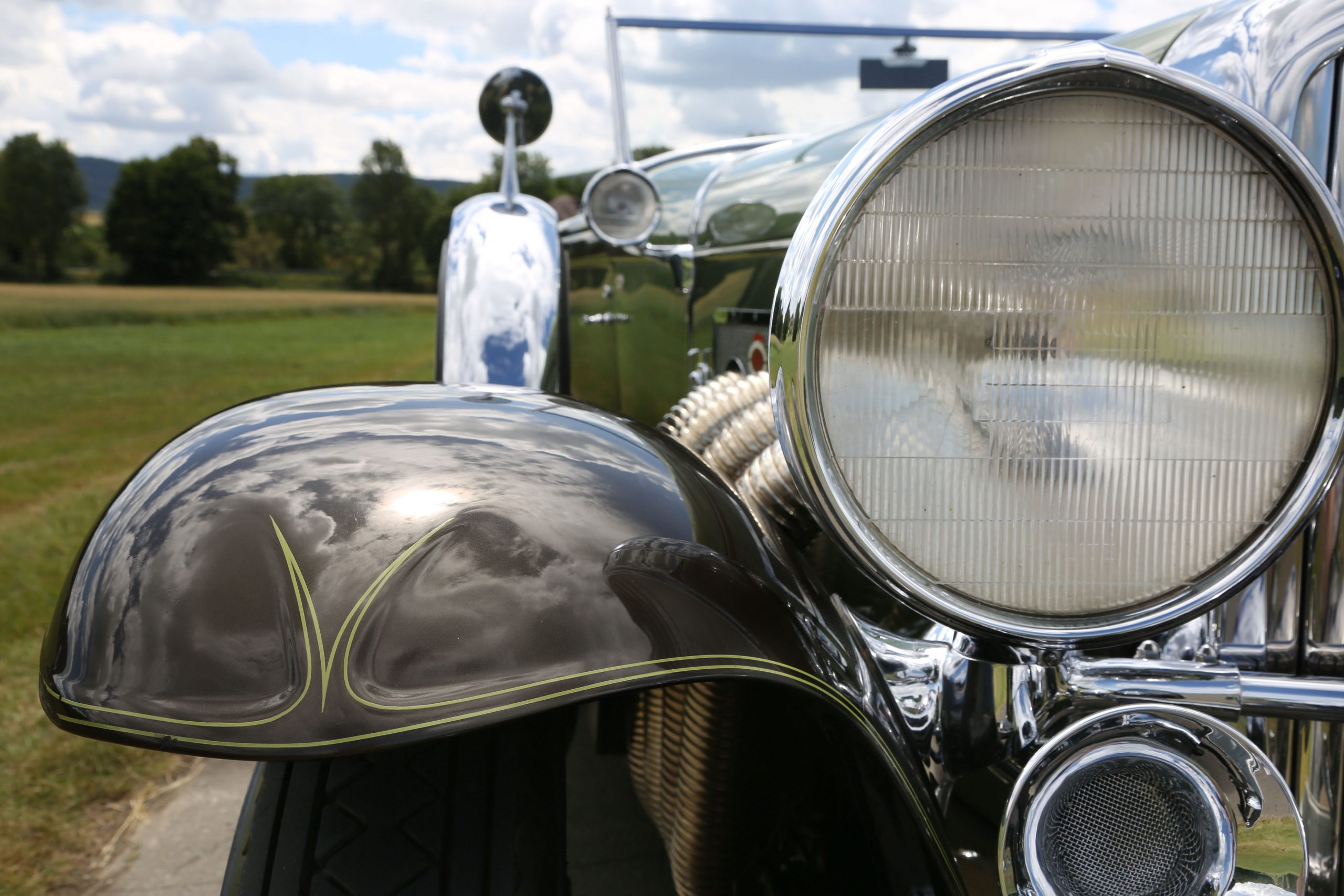 1929 Duesenberg Model SJ Convertible Sedan by Murphy pinstripe headlight