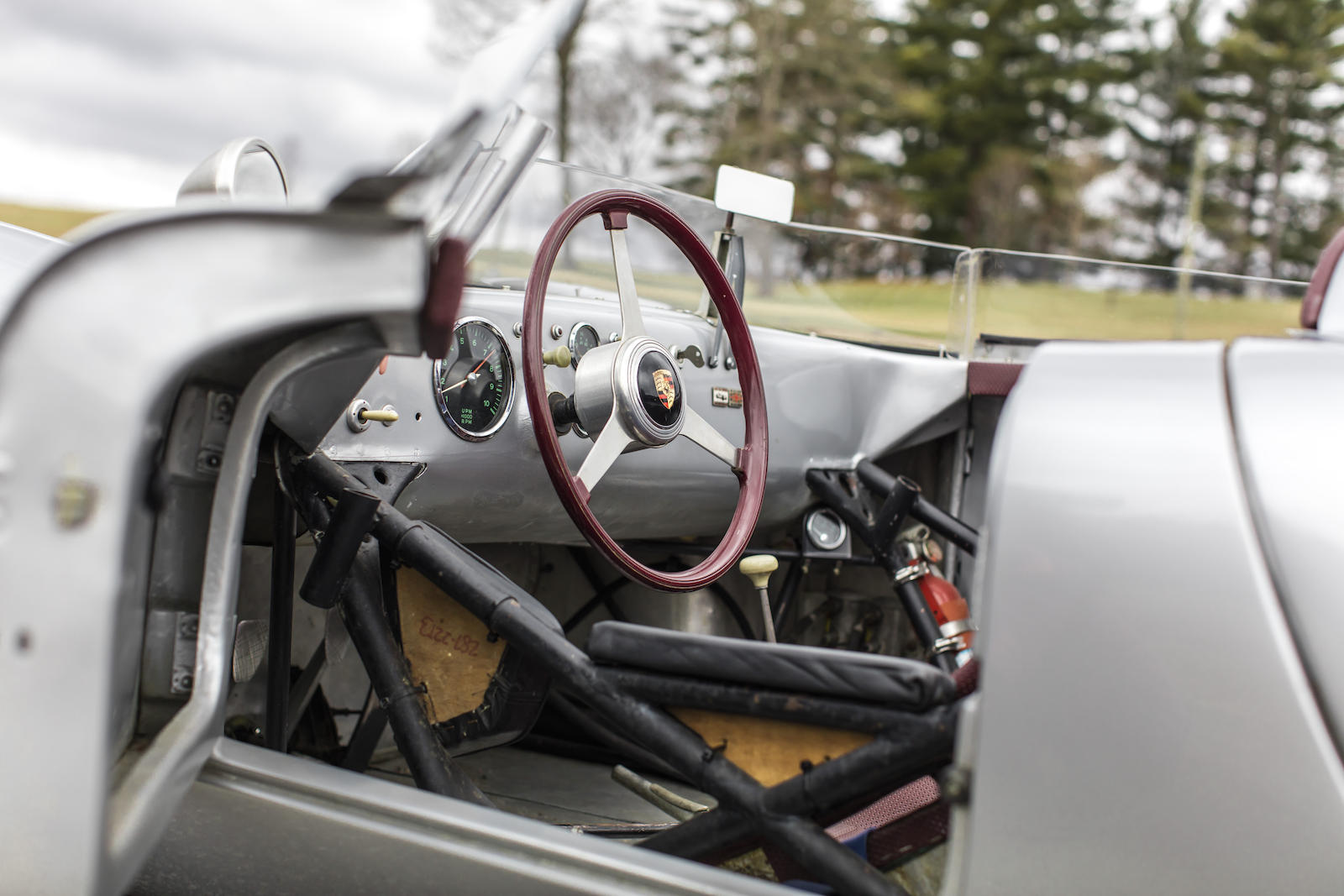 Silver Porsche 718 RSK Spyder Race Car interior cockpit