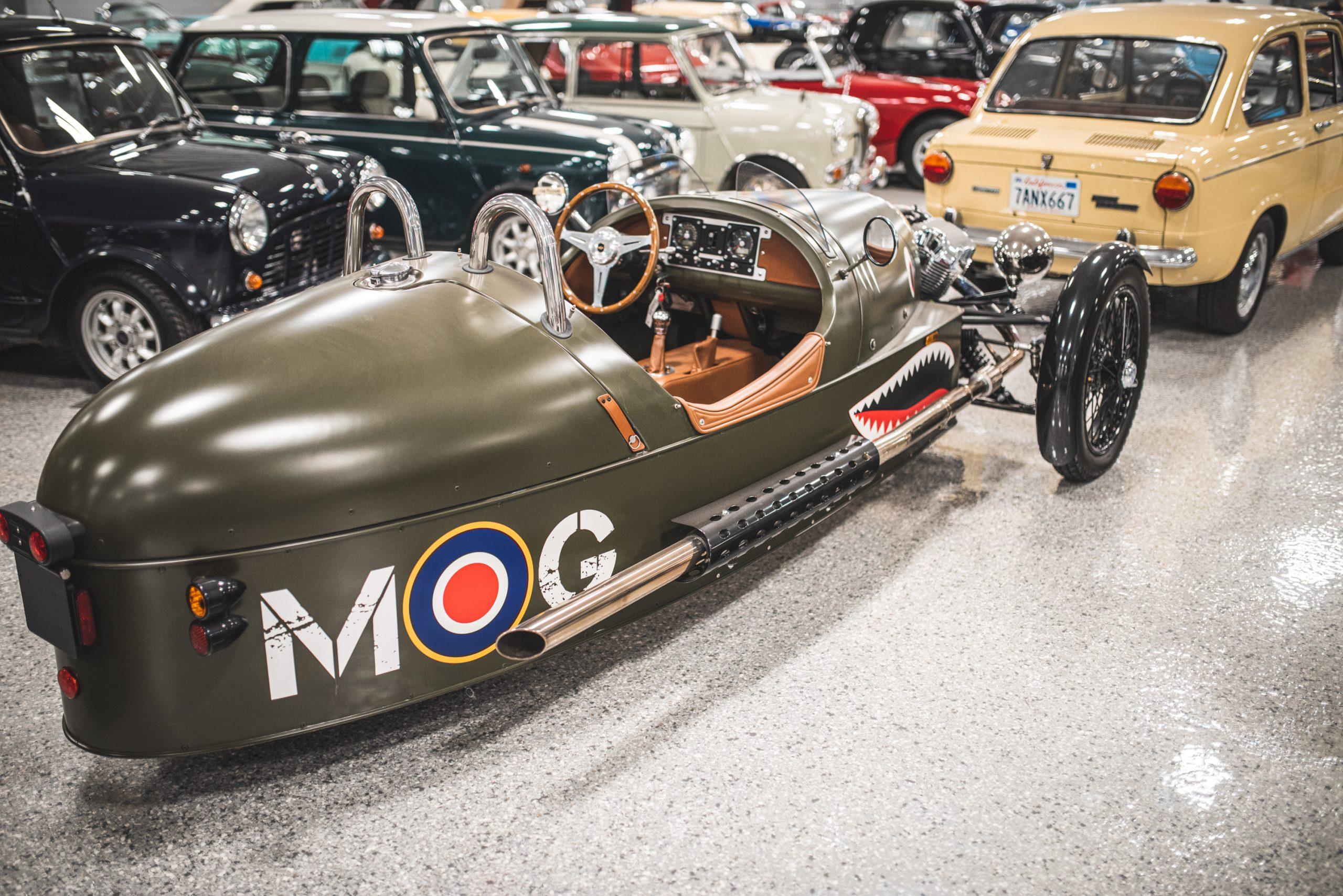 MOG olive green roadster rear three-quarter
