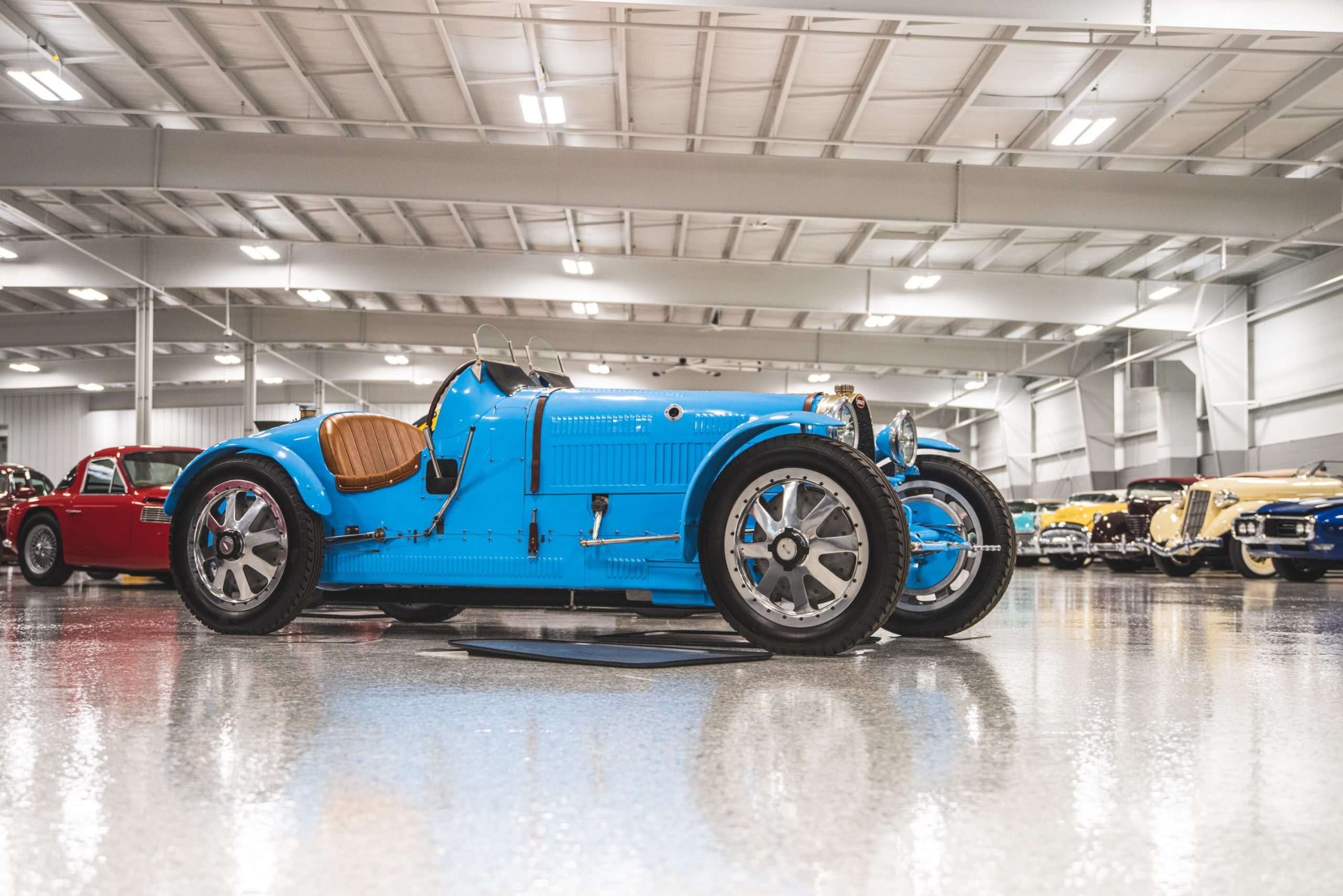 blue vintage bugatti roadster front three-quarter