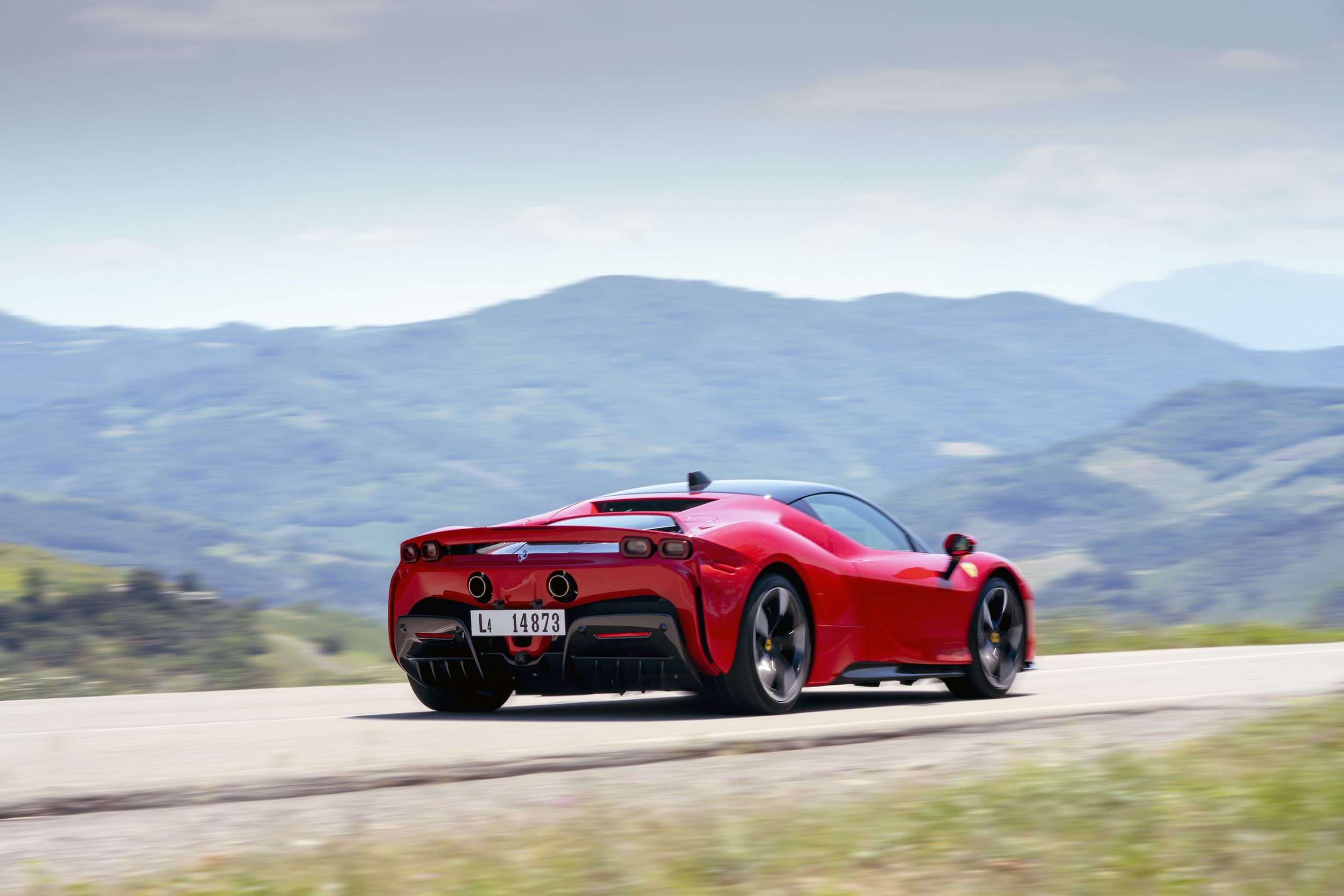 SF90 Stradale rear three-quarter road action