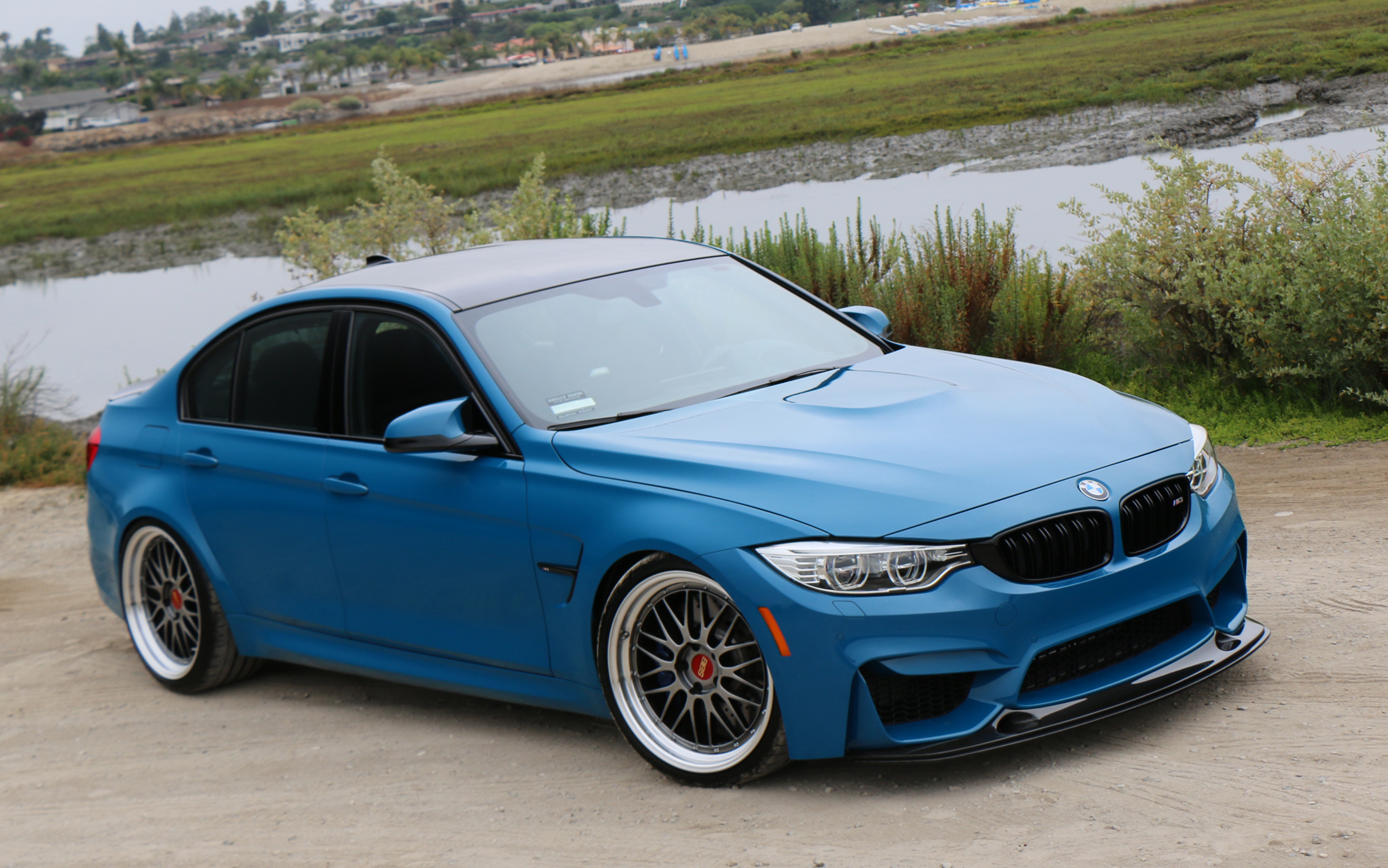 blue bmw front three-quarter with bbs wheels