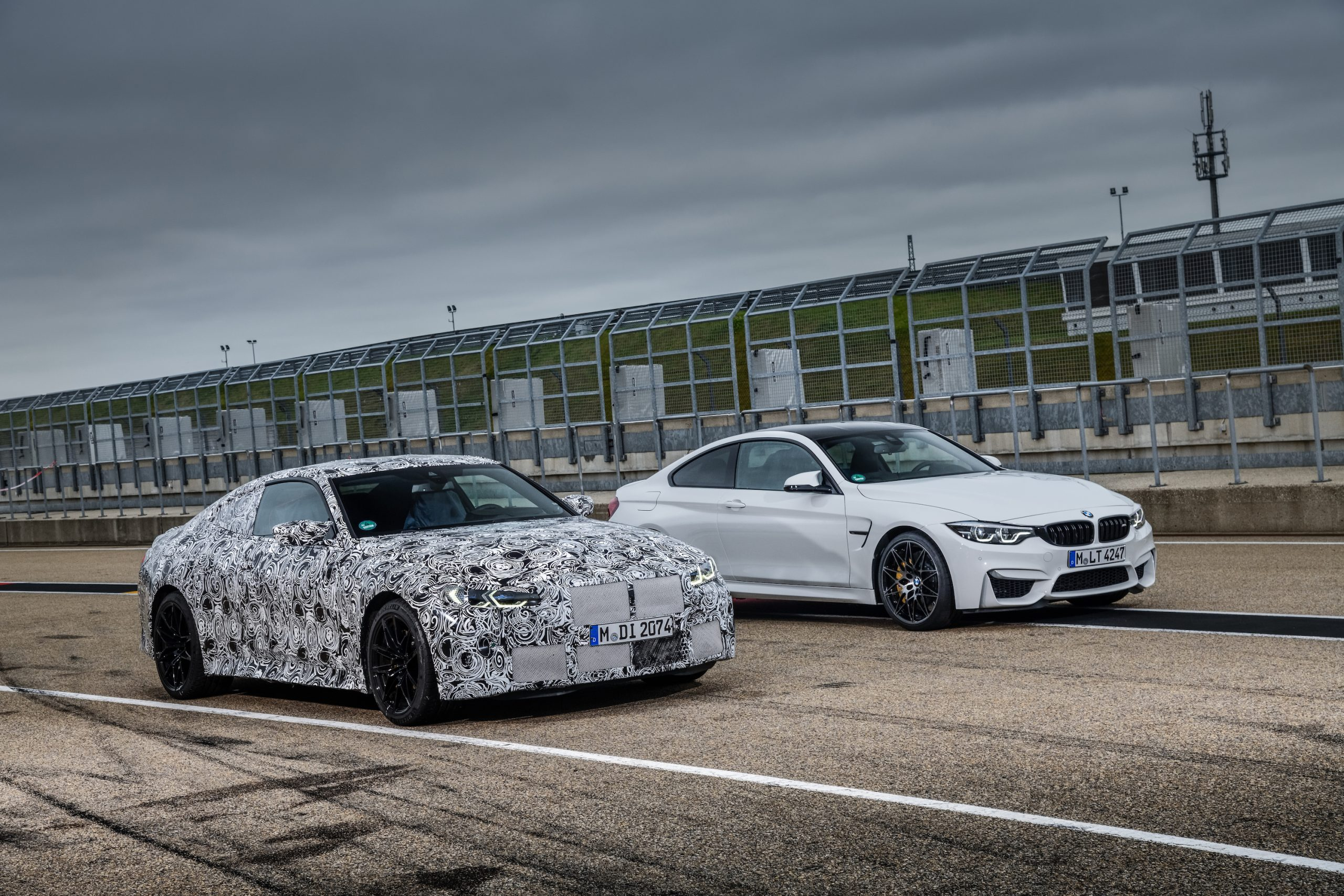 BMW M4 Coupe and M3 Sedan Front Three-Quarter