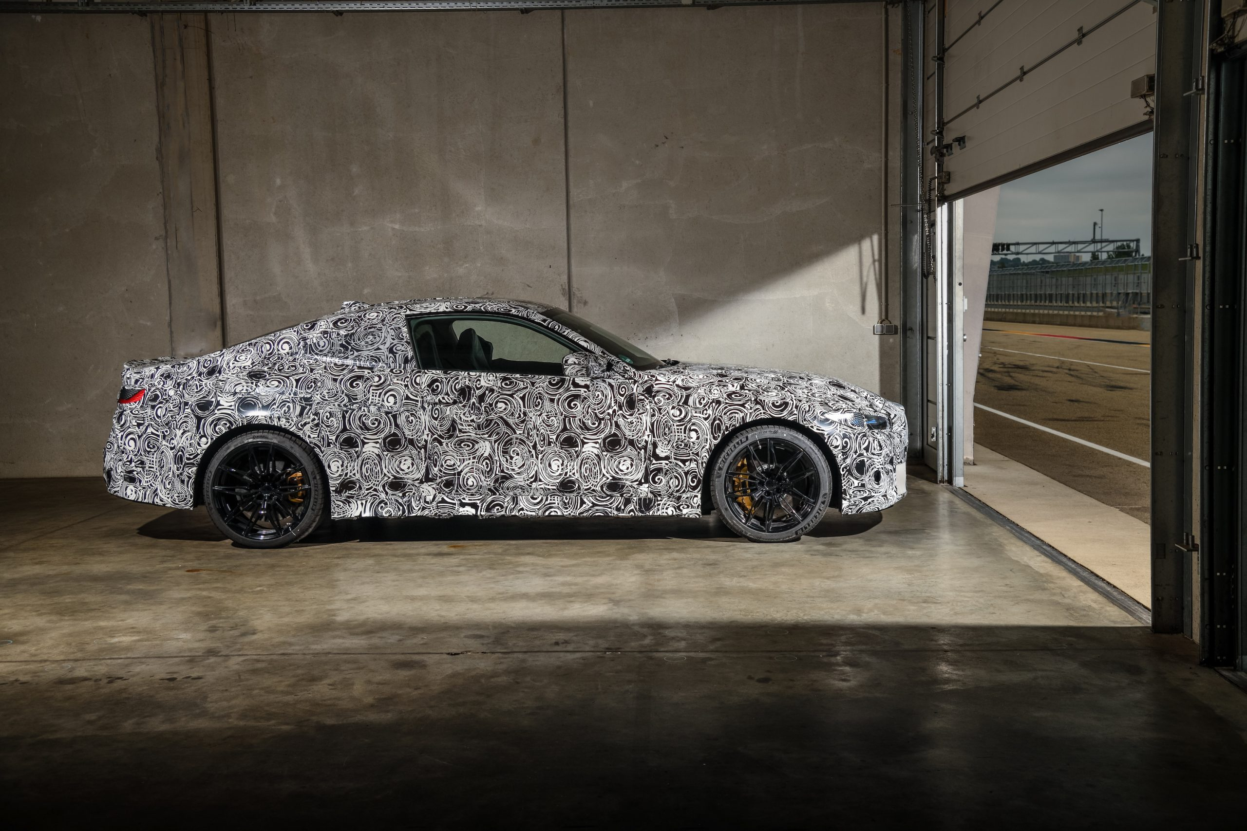 BMW M4 Coupe Side Profile in Garage