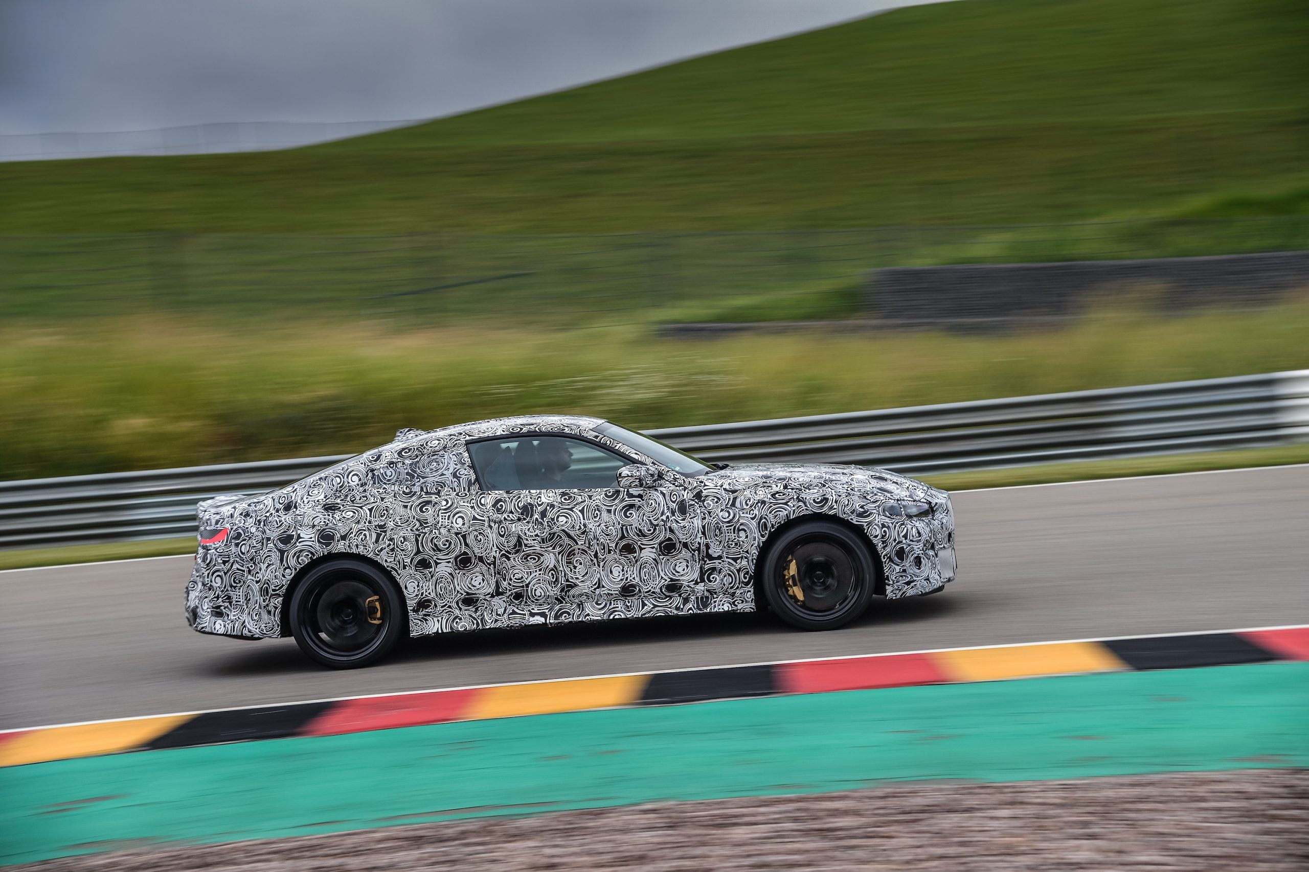 BMW M4 Coupe Side Profile Track Action
