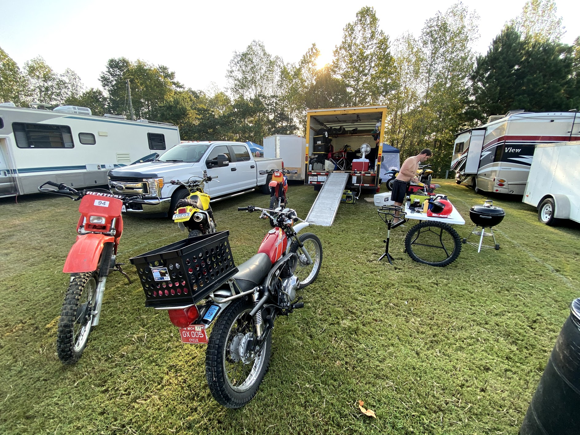 Barber bikes campers and moving truck camp
