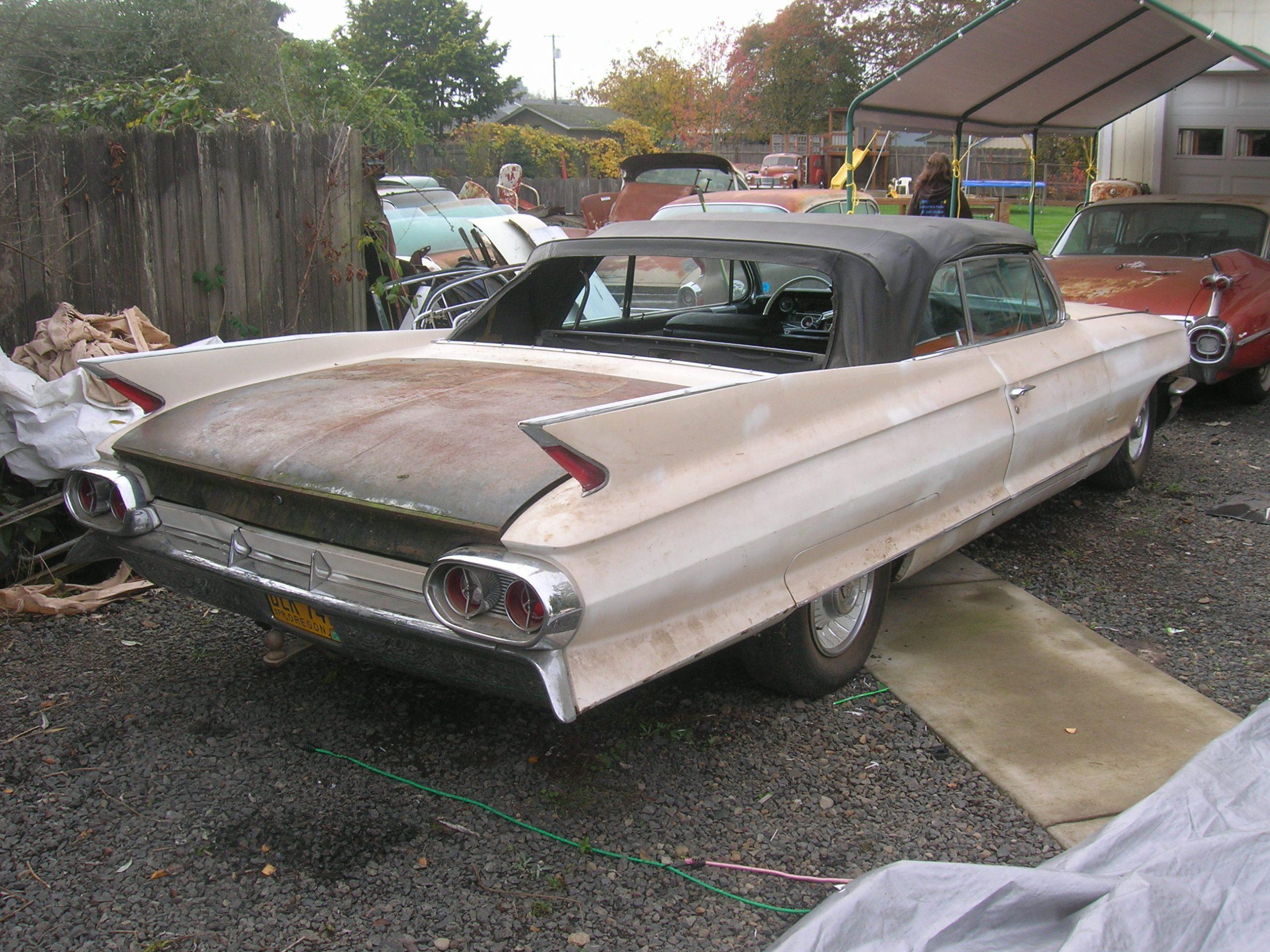 patina old vintage cadillac fins rear three-quarter