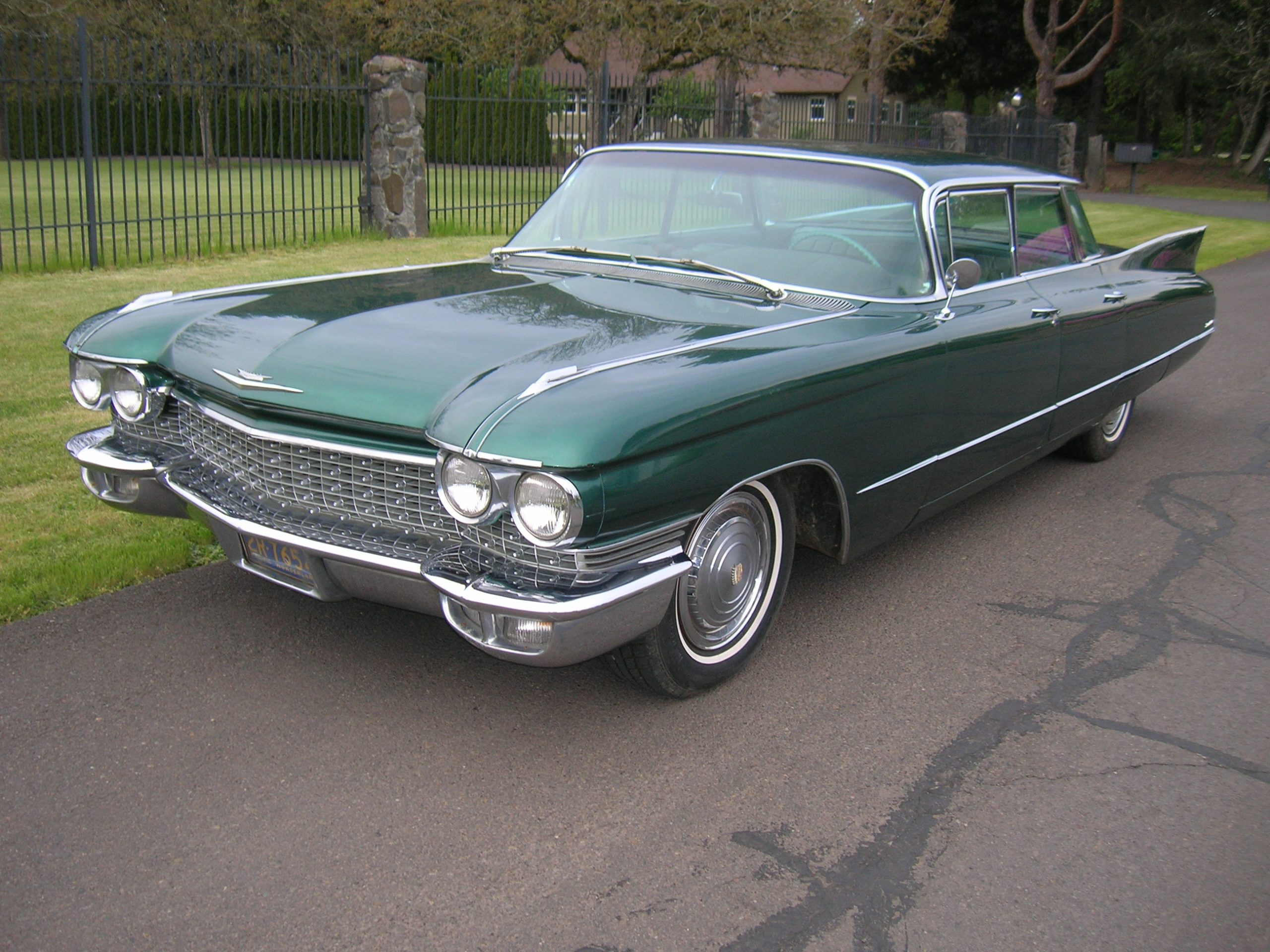 green old vintage cadillac front three-quarter