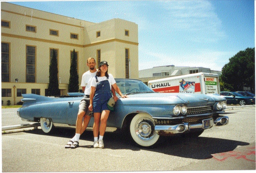 man and woman with old vintage cadillac uhaul