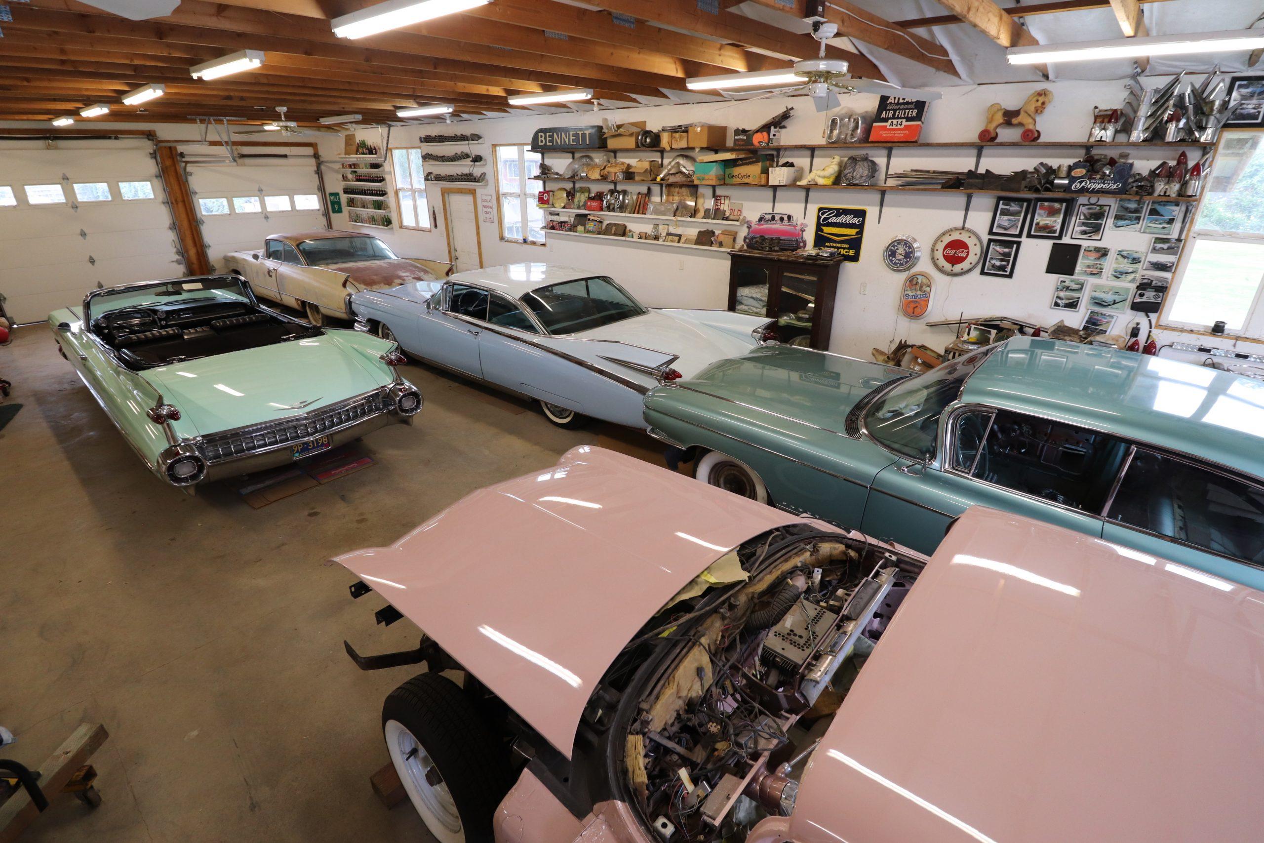 old vintage cadillac in garage rear three-quarter