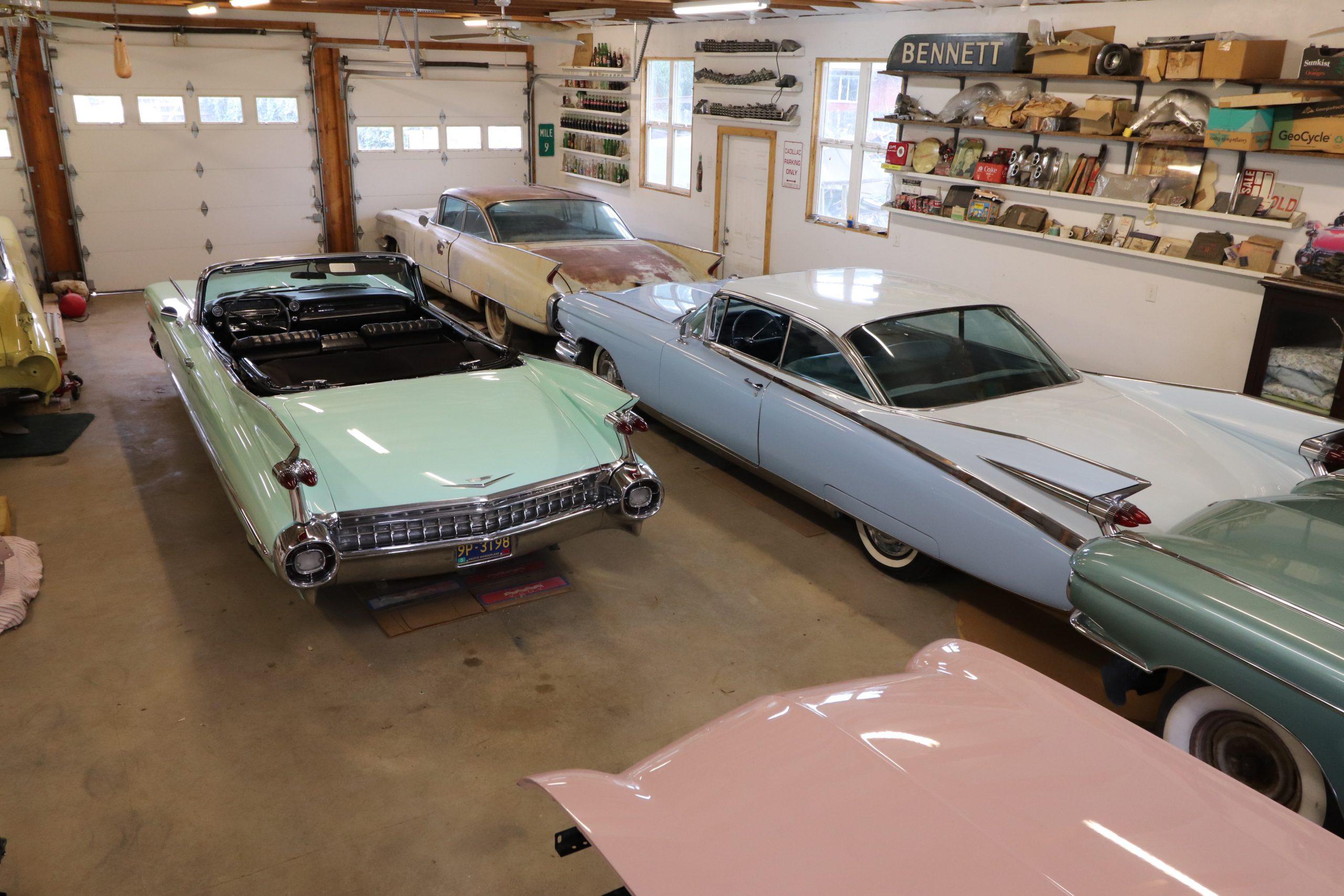 old vintage cadillacs in garage rear three-quarter